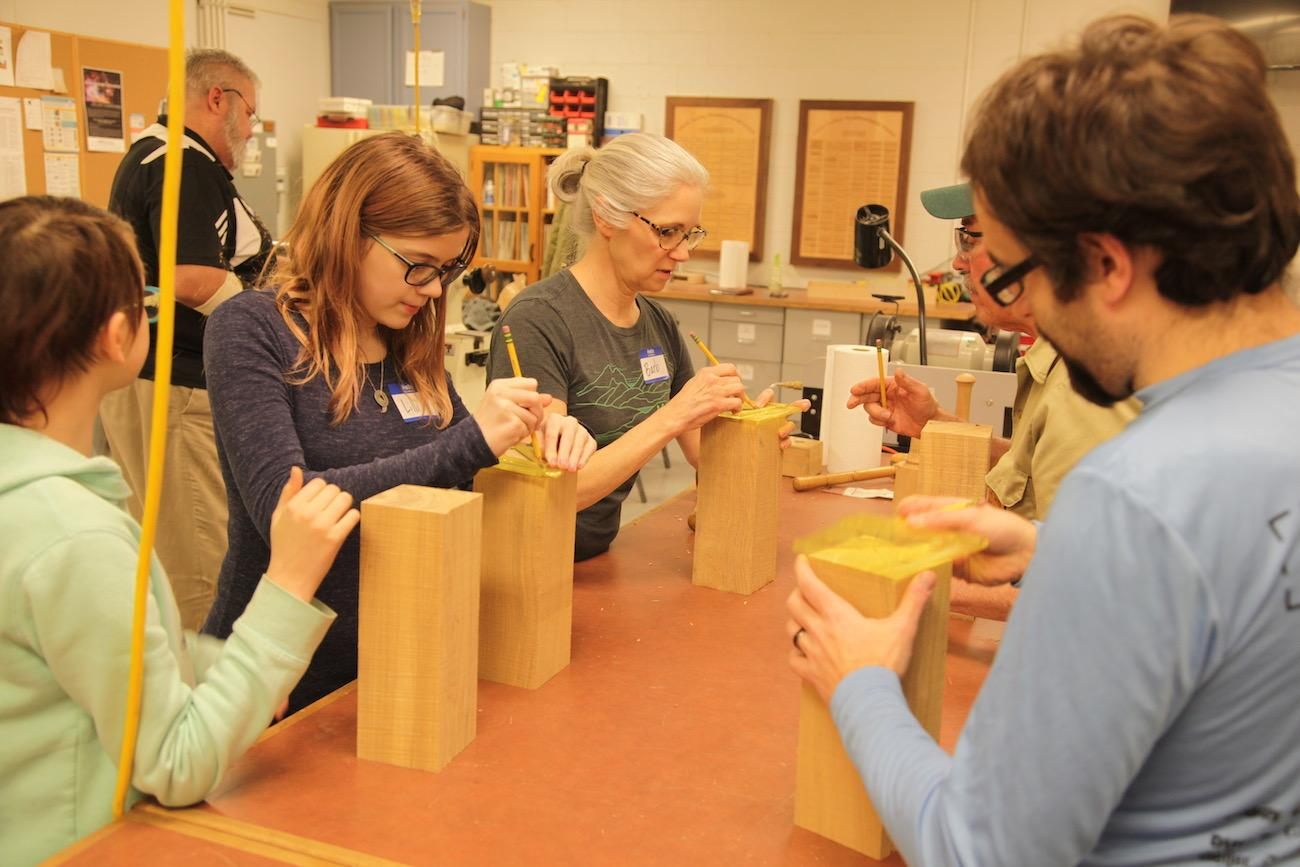 Ohio Valley Woodturners Guild mark the center points of their blocks to mount on the lathes. / Image: Chez Chesak // Published: 4.18.19