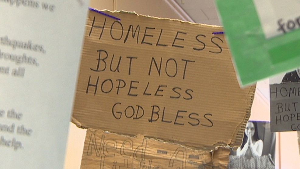 Seattle homeless but not helpless sign (KOMONews).jpg