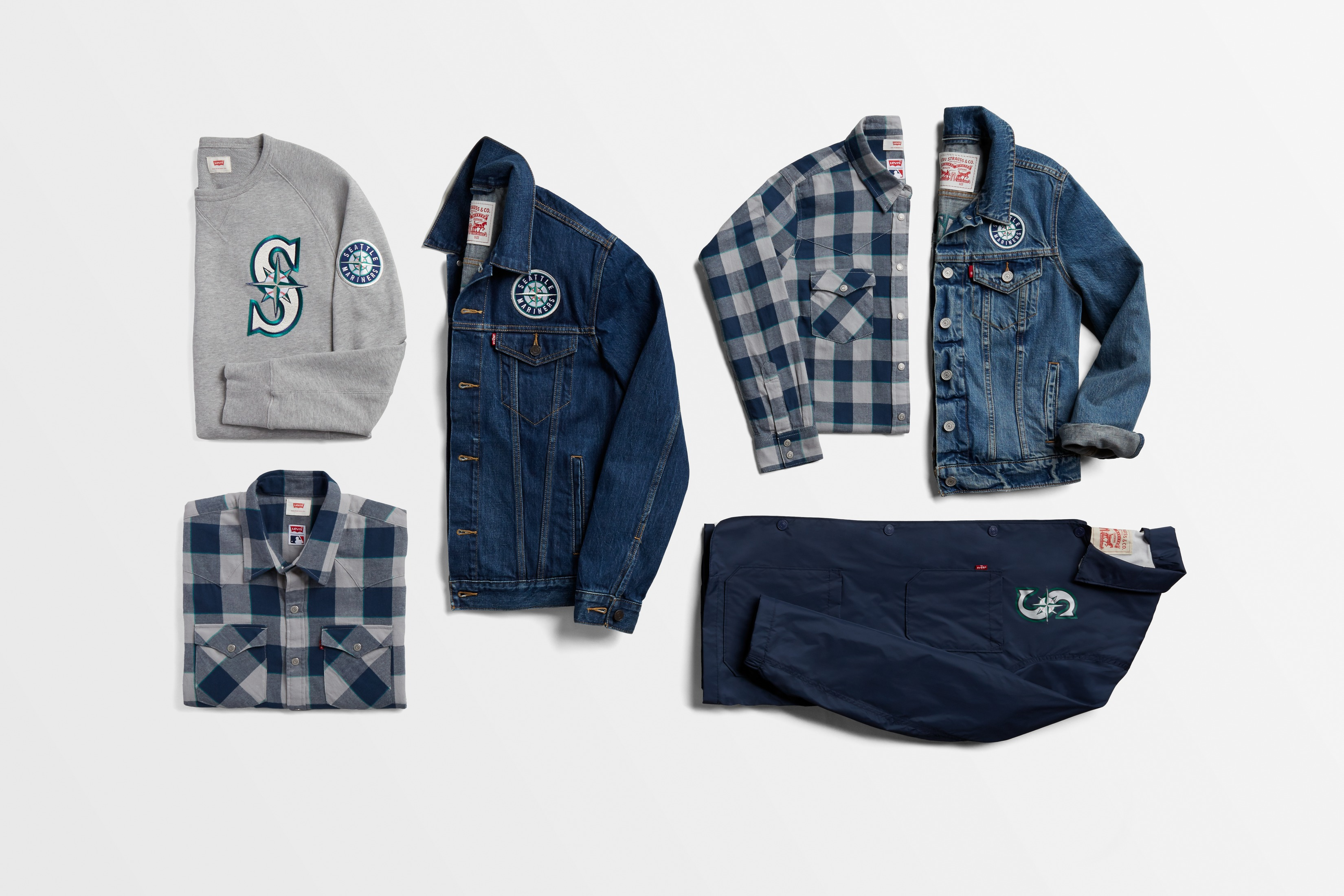 Just in time for baseball season, the new Levi's MLB Collection just announced that they are including Mariner's fan apparel! The Levi's MLB Collection is available for both men and women, and offers fans four different styles including the iconic denim Trucker, the Western plaid shirt, a crewneck sweatshirt, and vintage inspired Club Coat. The collection is available starting today, Friday March 31, on Levi.com. Get to gettin' and you'll probably be the most stylish fan at the Mariner's games. (Image courtesy of Levi's).