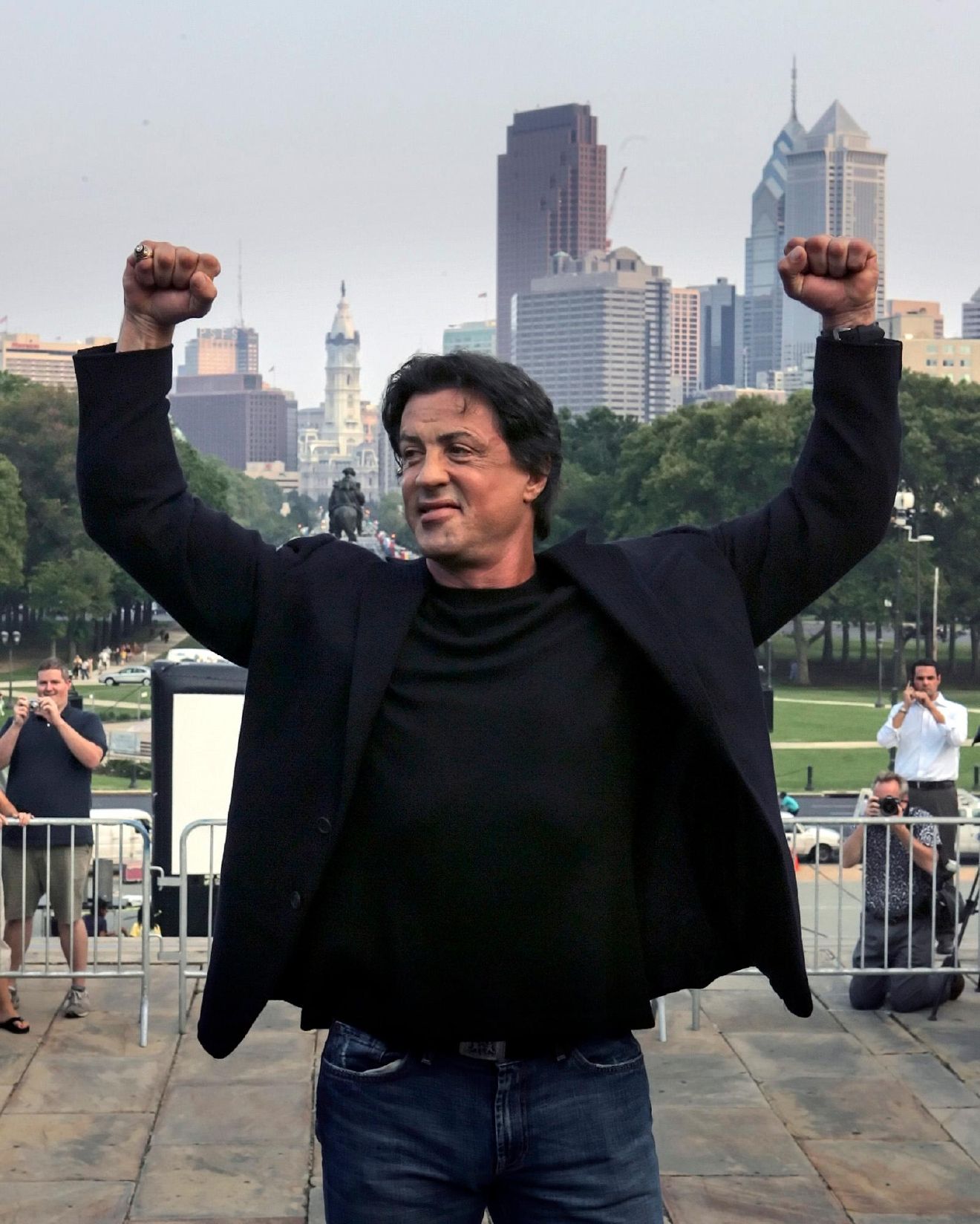 "FILE – In this Sept. 8, 2006, file photo, actor Sylvester Stallone poses at the top of the steps of the Philadelphia Museum of Art before a statue of Stallone portraying boxer Rocky Balboa is unveiled in Philadelphia. Four decades after the Nov. 21, 1976, premiere of ""Rocky,"" the movie's reach is international, and the title character's underdog tale of determination, grit and sleepy-eyed charm still resonates with fans. (AP Photo/Rusty Kennedy, File)"