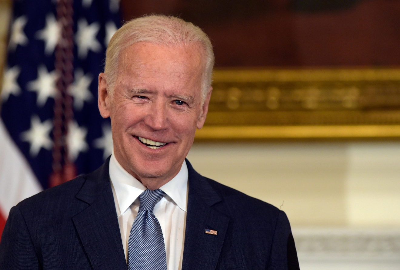 "FILE - In this Jan. 12, 2017 file photo, Vice President Joe Biden smiles in the State Dining Room of the White House in Washington. Biden is backing Tom Perez to head the Democratic National Committee, calling the Obama administration labor secretary the ""best bet to help bring the party back.""  (AP Photo/Susan Walsh, File)"