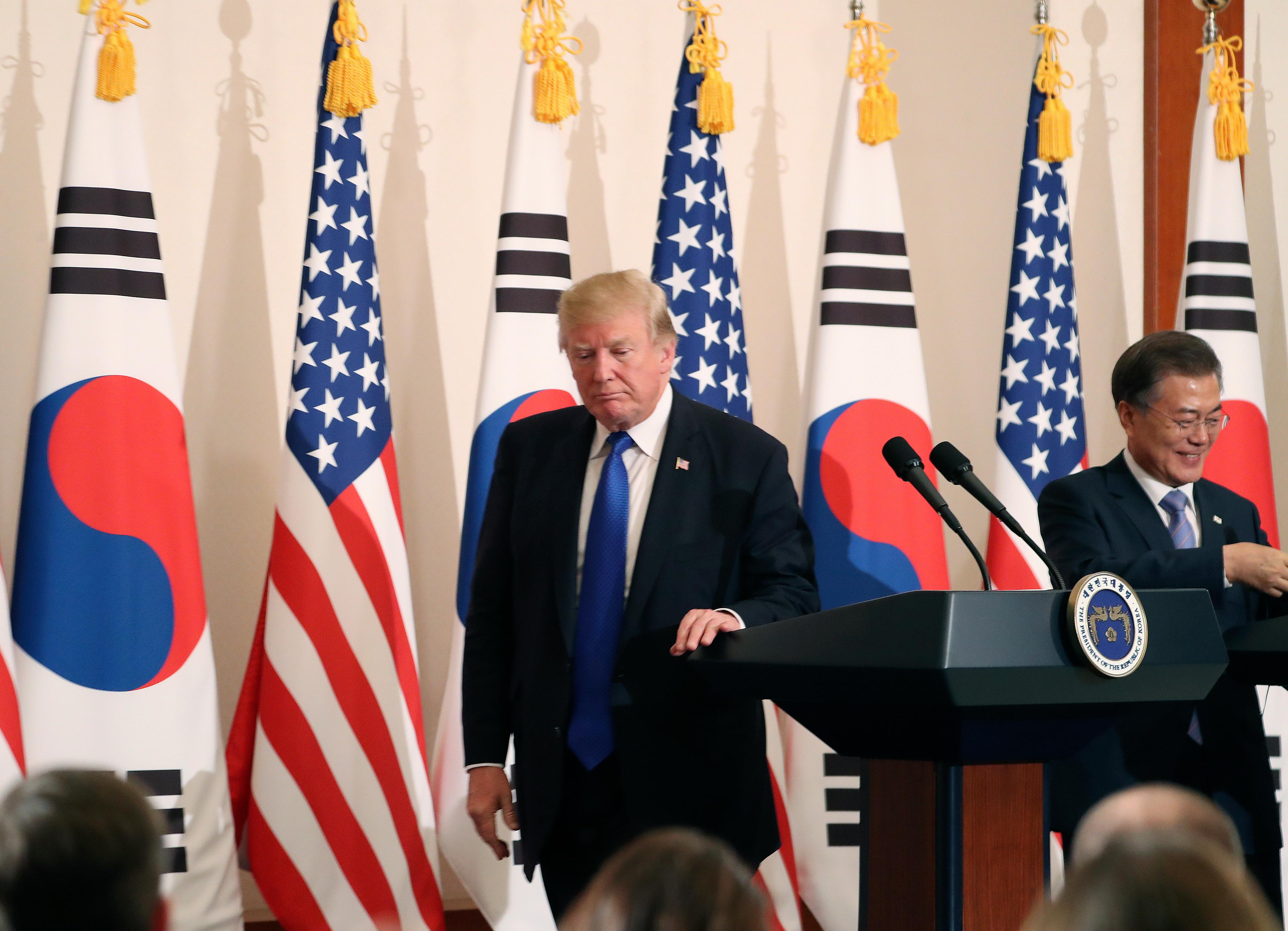 "President Donald Trump, left, leaves a joint news conference with South Korean President Moon Jae-in, right, at the Blue House in Seoul, South Korea, Tuesday, Nov. 7, 2017. President Trump, on his first day on the Korean peninsula, signaled a willingness to negotiate with North Korea to end its nuclear weapons program, urging Pyongyang to ""come to the table"" and ""make a deal."" (AP Photo/Andrew Harnik)"