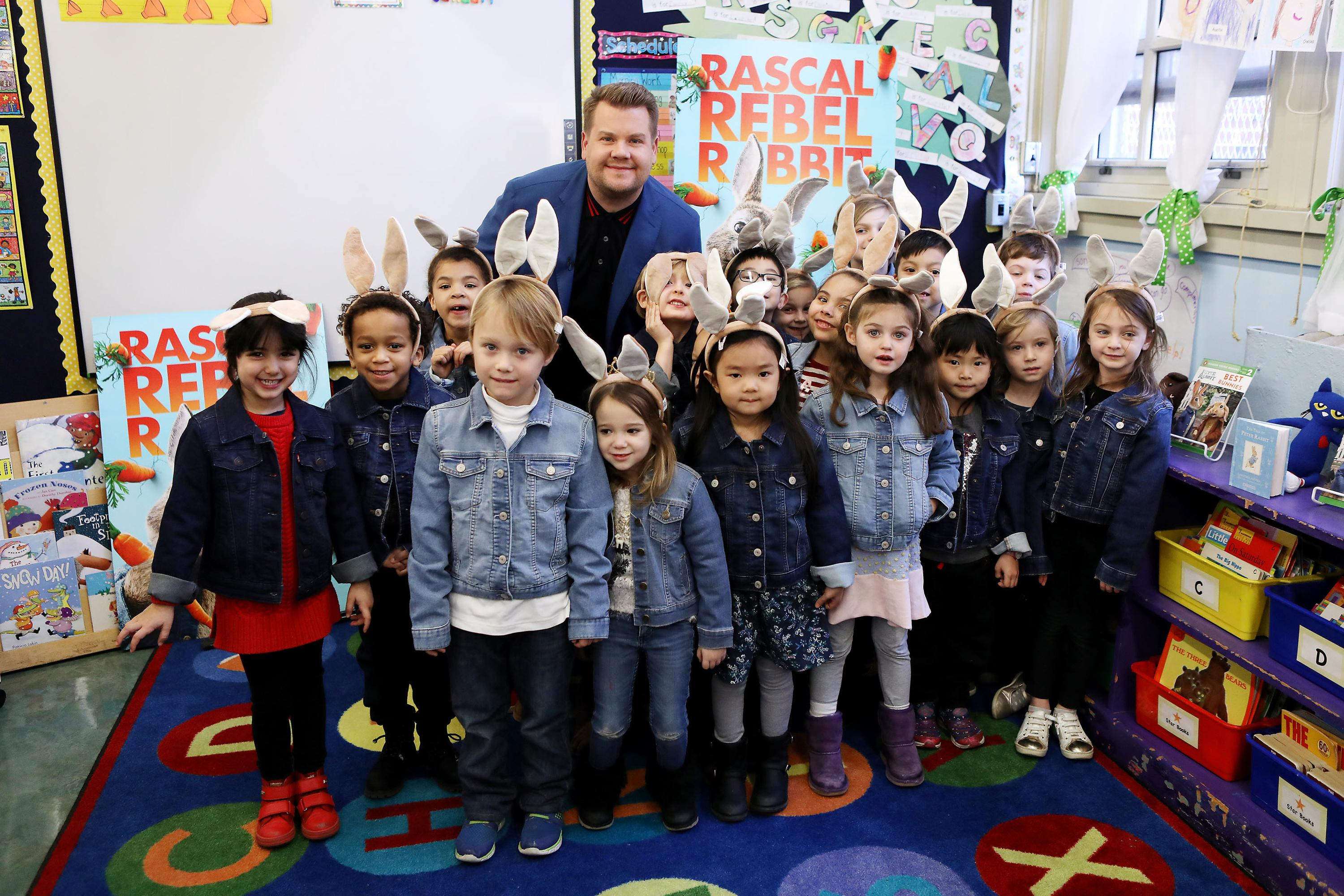 New York, NY - 1/25/18  - James Corden with students at New York City School to announce Blue Jacket Day on behalf of Columbia Pictures' PETER RABBIT.{ }(Photo:  Patrick Lewis courtesy of Sony Pictures)