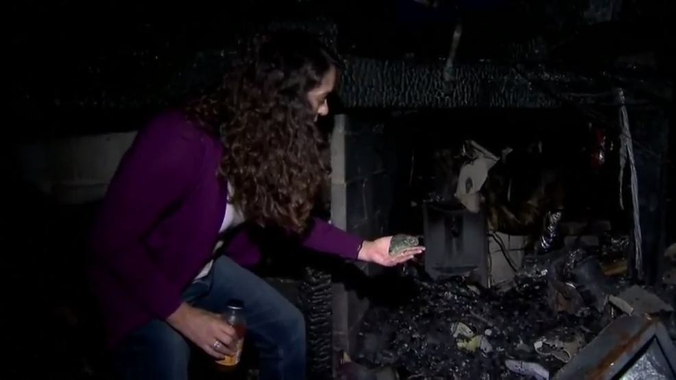 Michella Flores surveys the damage at her Santa Rosa home.png