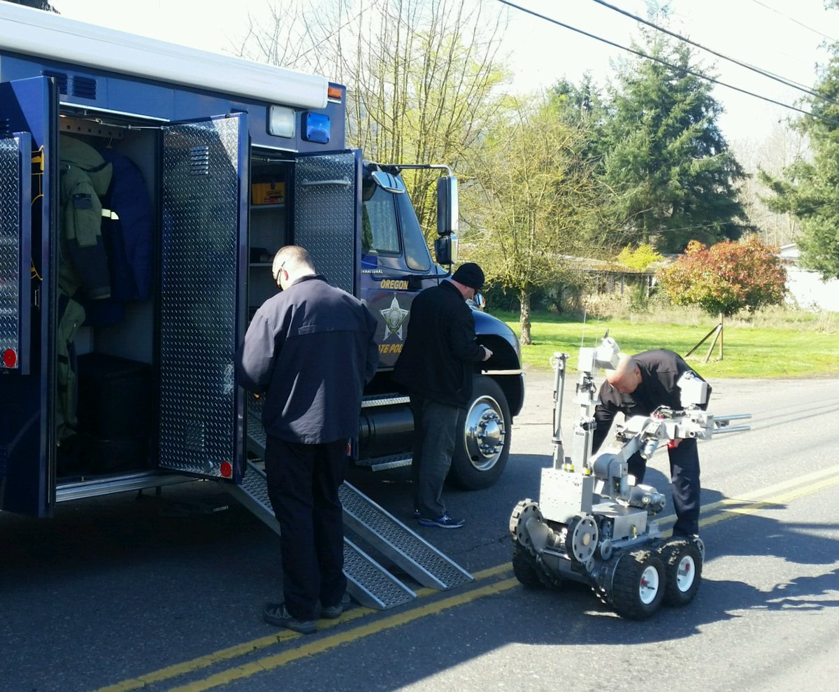OSP Bomb Techs with the robot - Oregon State Police image
