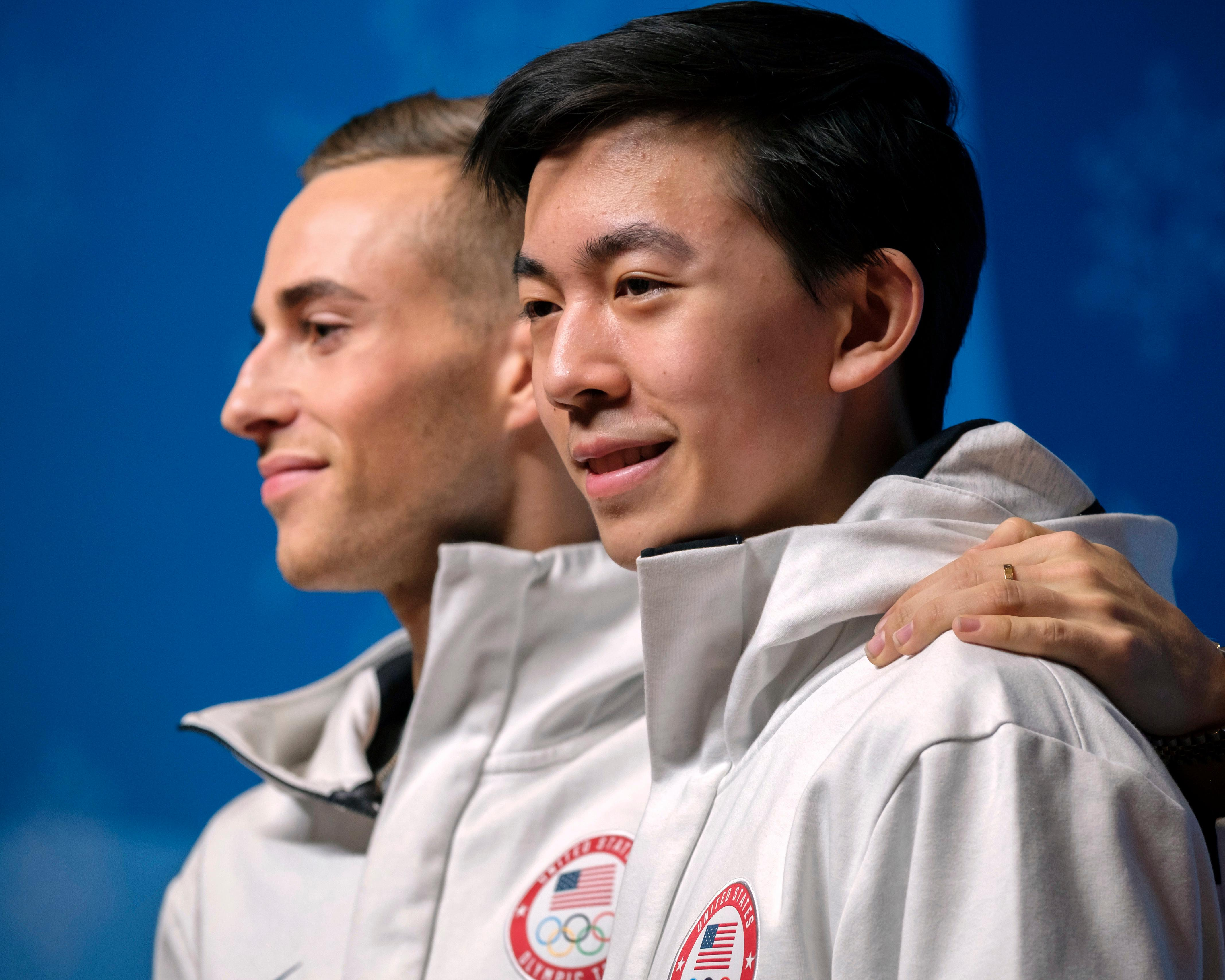 "In this Tuesday, Feb. 13, 2018 photo, United States figure skaters Adam Rippon, left, and Vincent Zhou pose for cameras after a press conference at the 2018 Winter Olympics in Pyeongchang, South Korea. Food is a big deal for Olympians. The U.S. team has its own chefs and dietitians, as well as two ""nutrition centers"" at the Winter Olympics. Zhou said he needs a lot of carbs, ""before, between and after sessions,"" to fend off fatigue. While Rippon said sheer abundance can be a danger for athletes.  (AP Photo/J. David Ake)"
