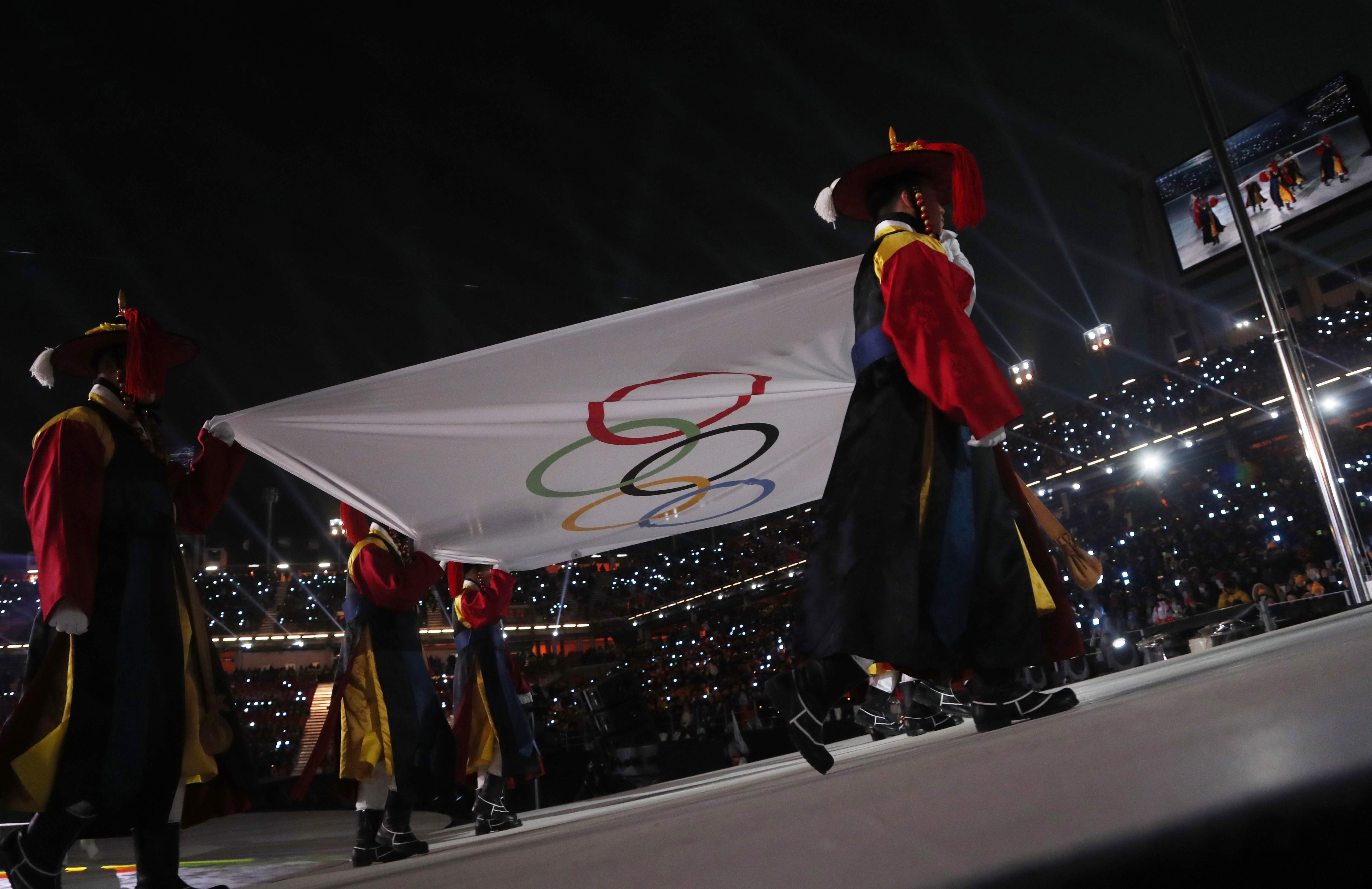 The Olympic flag is carried into the stadium during the opening ceremony of the 2018 Winter Olympics in Pyeongchang, South Korea, Friday, Feb. 9, 2018. (AP Photo/Petr David Josek)