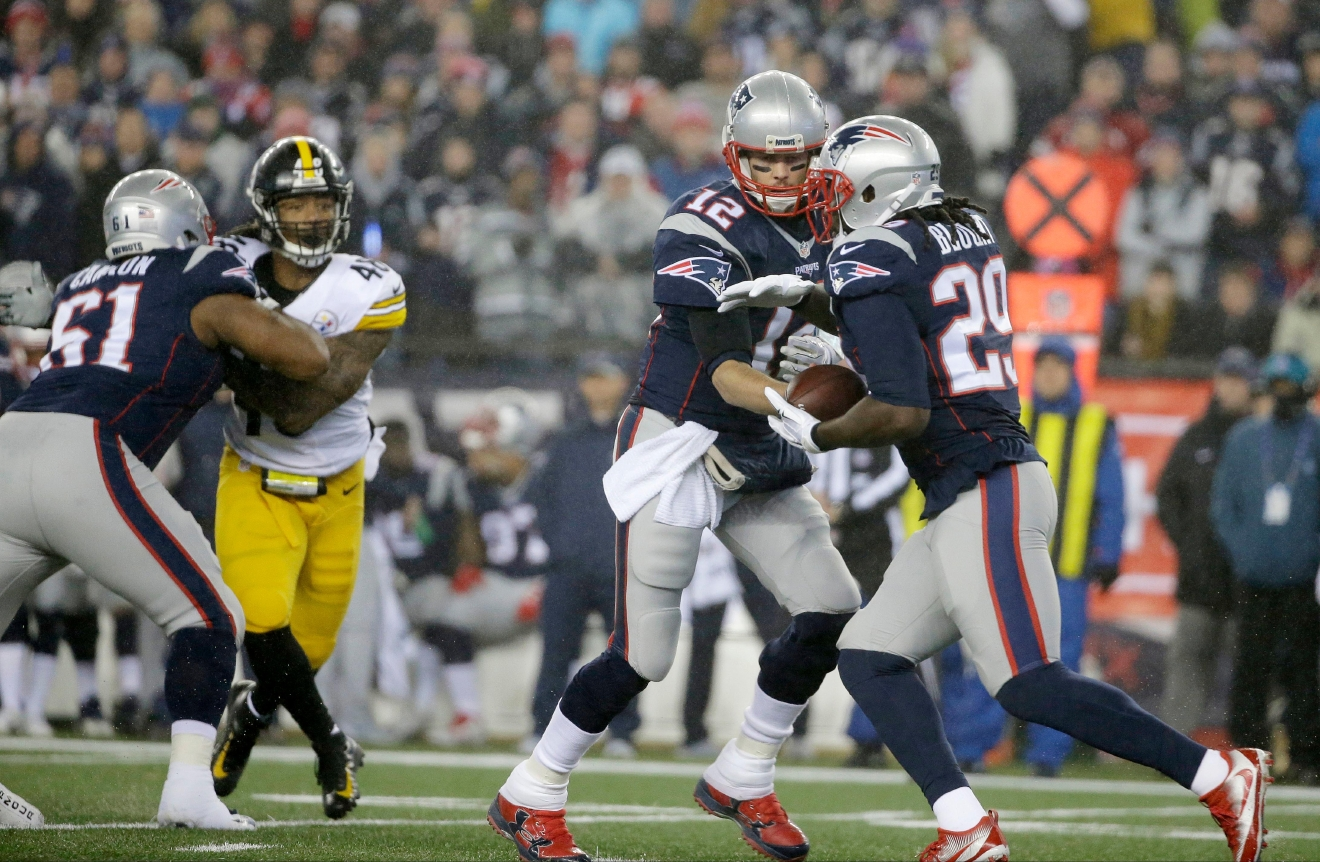 New England Patriots quarterback Tom Brady (12) hands the ball to running back LeGarrette Blount (29) during the first half of the AFC championship NFL football game against the Pittsburgh Steelers, Sunday, Jan. 22, 2017, in Foxborough, Mass. (AP Photo/Steven Senne)