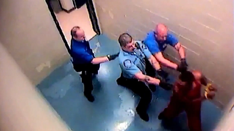 Police camera shows officers struggling with Rosalio Ramos-Ramos in custody. Ramos is accused of stabbing his cousin then dismembering the man last month, should have been in the custody of federal immigration agents. (Photo: via KOMO News)<p></p>