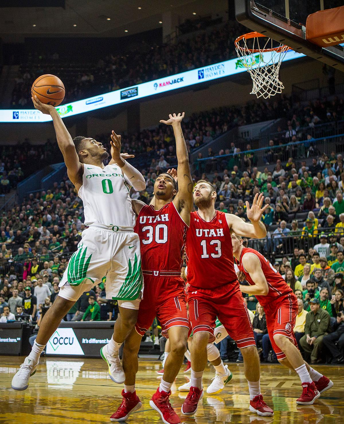 Oregon Ducks Troy Brown (#0) looks for the basket. The Utah Utes defeated the Oregon Ducks 66-56 on Friday night at Matthew Knight Arena. This is the first Pac-12 conference game loss at home for the Ducks since January of 2015. This also ended the five home game winning streak for the Ducks against the Utah Utes. Photo by Rhianna Gelhart, Oregon News Lab