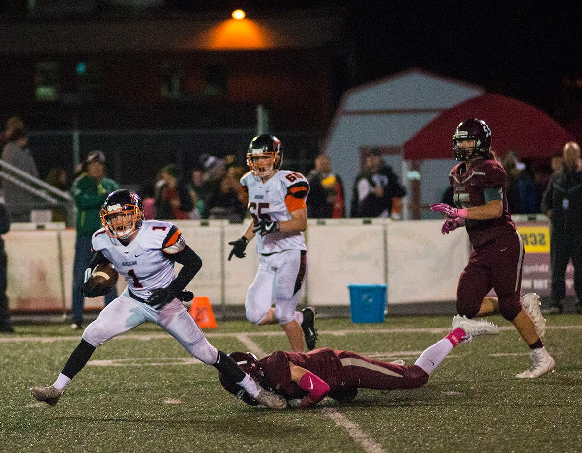 Roseburg Indians Garrett Russell (#1) attempts to escape Willamette's defense. Roseburg Indians defeated Willamette Wolverines 21-20 at Wolverine Stadium on Friday night in Eugene. Photo by Rhianna Gelhart, Oregon News Lab