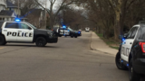 Police surround home in Kalamazoo for suspect wanted on warrants