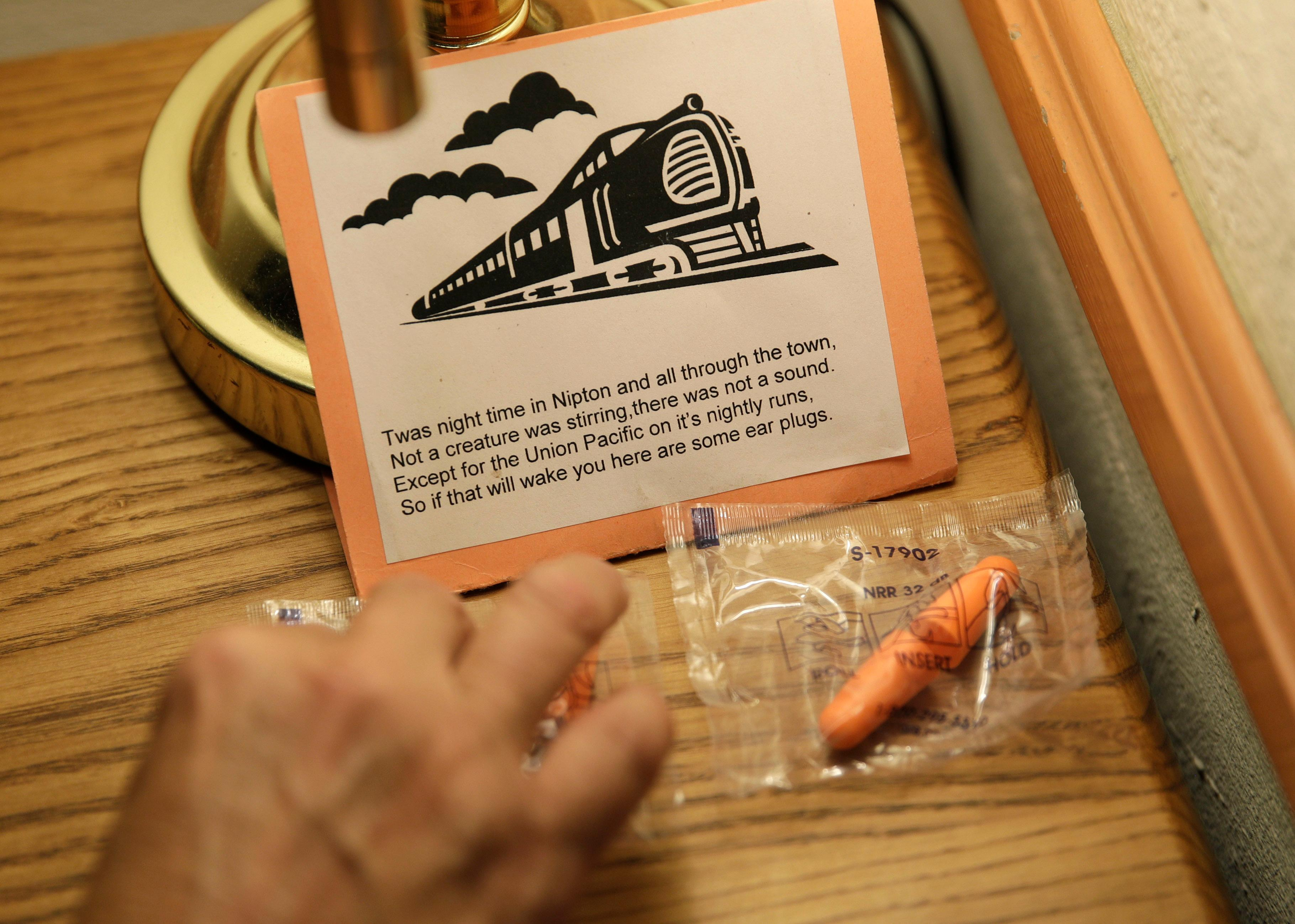 Laura Cavaness places earplugs to block out noise from passing trains in a room at the Hotel Nipton, Thursday, Aug. 3, 2017, in Nipton, Calif. American Green Inc., one of the nation's largest cannabis companies, announced it has bought the entire 80 acre California desert town of Nipton. (AP Photo/John Locher)