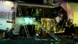 Tour bus hits truck, killing 13, injuring 31 in California