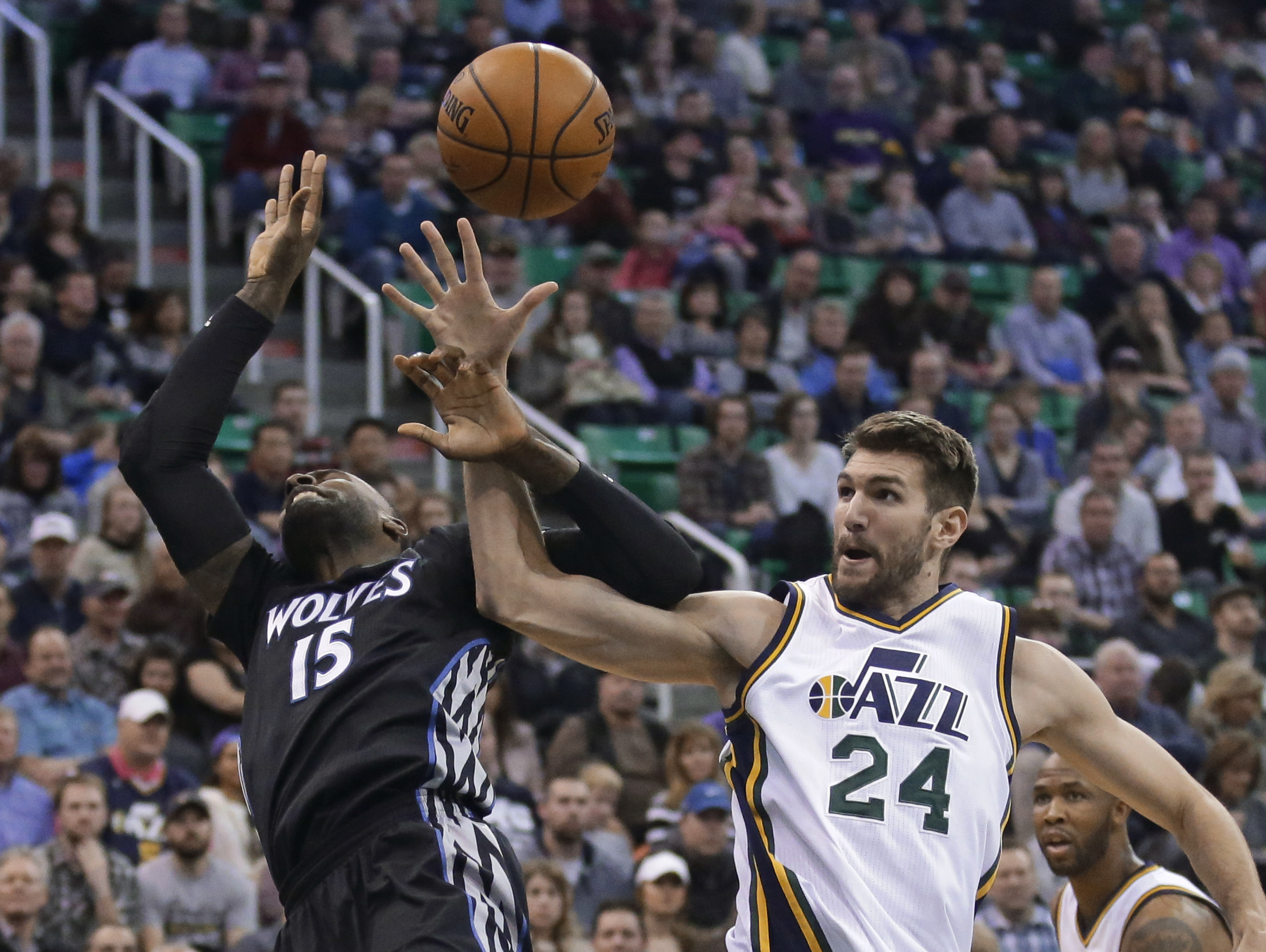 Minnesota Timberwolves forward Shabazz Muhammad (15) and Utah Jazz center Jeff Withey (24) compete for a rebound during the second quarter of an NBA basketball game Friday, Jan. 29, 2016, in Salt Lake City. (AP Photo/Rick Bowmer)