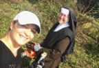 Nun cutting a tree2.PNG