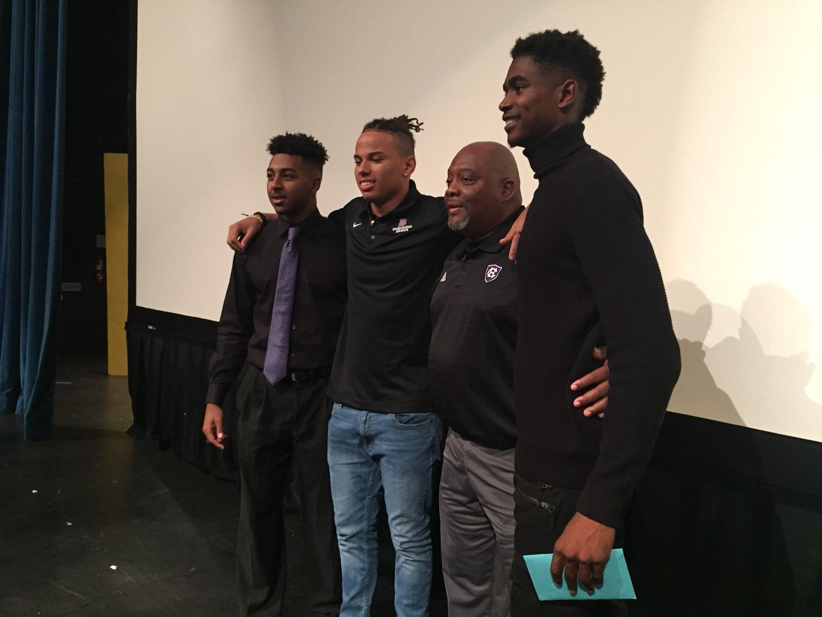 Football players John Smith, Jake Collins and Atorian Perry pause for pictures with Park Vista's Coach Smith.