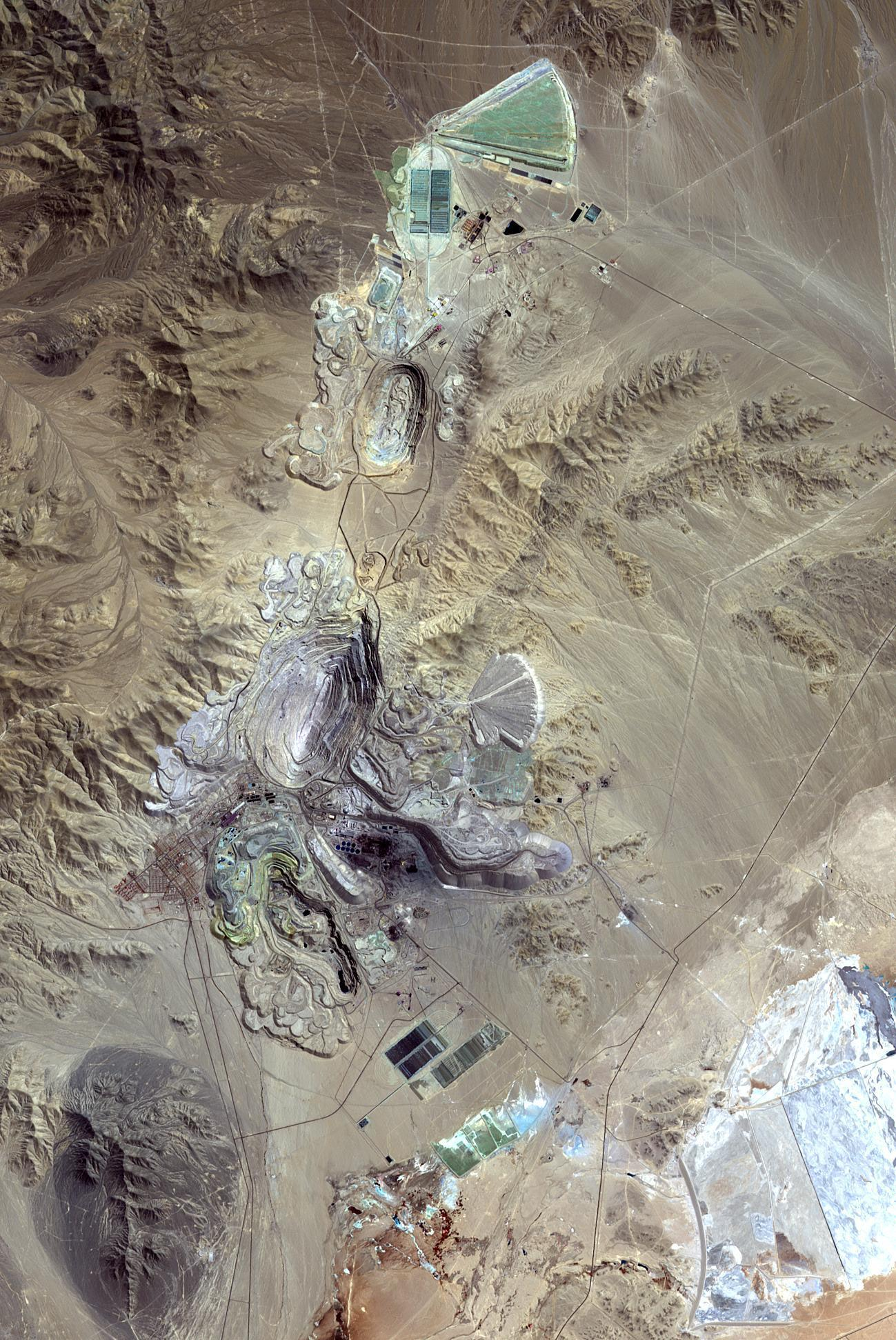 PICTURE SHOWS: Chuquicamata, in Chile's Atacama Desert, is the largest open pit copper mine in the world, by excavated volume. The image was acquired September 2, 2007, covers an area of 19.5 by 29.3 km.  ...   Prepare to have your mind blown - NASA has collected together a treasure trove of more than 140,000 images, videos and audio files.  The stunning collection consolidates imagery spread across more than 60 collections into one searchable location, called the NASA Image and Video Library website.  Cover Images have chosen a gallery of the most popular images currently on the website, which include the first American astronaut to walk in space and a self-portrait of NASA's Curiosity Mars rover.  The portal allows users to search and discover content from across the agency's many missions in aeronautics, astrophysics, Earth science, human spaceflight, and more.  The library is not comprehensive, but rather provides the best of what NASA makes available from a single point of presence on the web. Additionally, it is a living website, where new and archival images, video and audio files continually will be added.  When: 24 Aug 2016