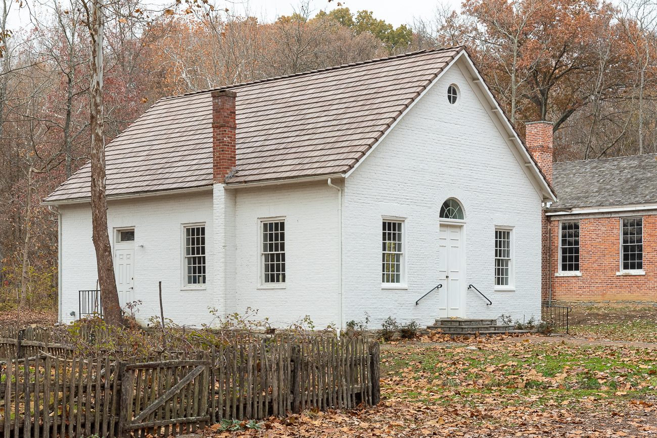 Somerset Church, a former Presbyterian church, once stood in Fields-Ertel where a Meijer gas station now stands today. It claimed that land from 1829 to 1991 when it was then relocated to Heritage Village. James Kemper, whose log house stands feet away from Somerset Church today, was the purveyor of Presbyterian churches in the area in the early 1800s. Today, it's not only a part of the historic fabric of Heritage Village, but a functioning part of it, too; Somerset Church can be used for weddings and other special events.{ }/ Image: Phil Armstrong, Cincinnati Refined // Published: 12.5.19