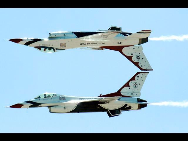 Two U.S. Air Force Thunderbirds perform an inverted formation fly-by during the Thunder and Lightning Over Arizona event at Davis-Monthan Air Force Base, Ariz., April 13, 2014.