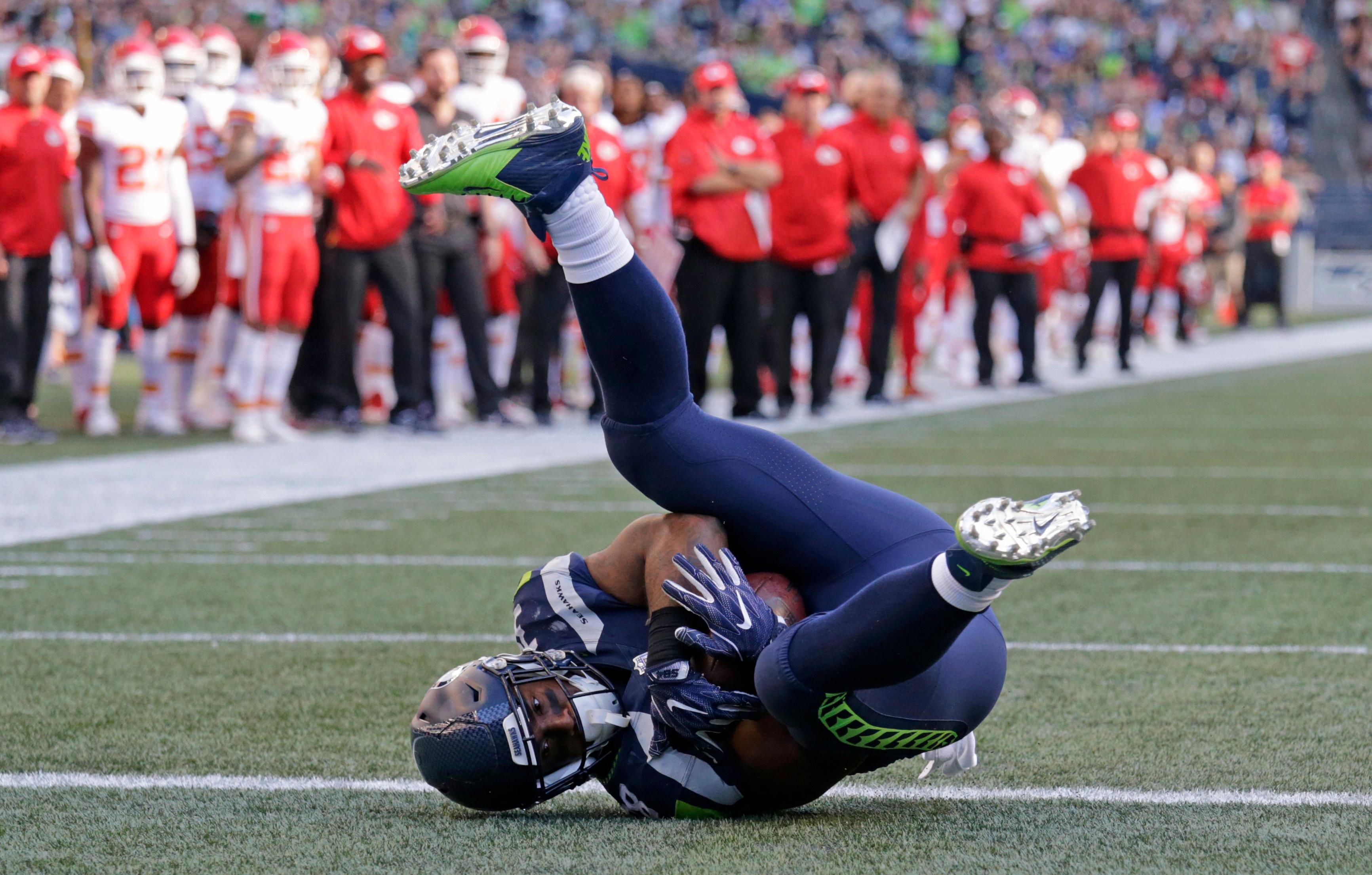 Seattle Seahawks fullback Tre Madden tumbles into the end zone for a touchdown against the Kansas City Chiefs during the first half of an NFL football preseason game, Friday, Aug. 25, 2017, in Seattle. (AP Photo/John Froschauer)