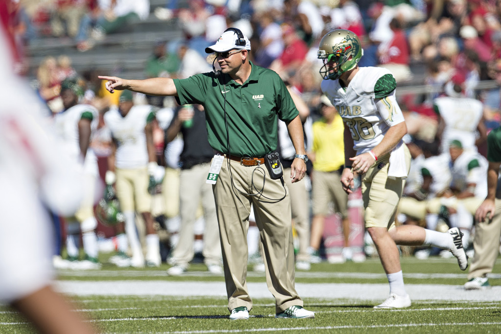 UAB head coach Bill Clark directs his team during a 45-17 loss at Arkansas on Oct. 25, 2014. The football program was shut down after the season and returns this year after a two-year hiatu.  (Photo by Wesley Hitt/Getty Images)