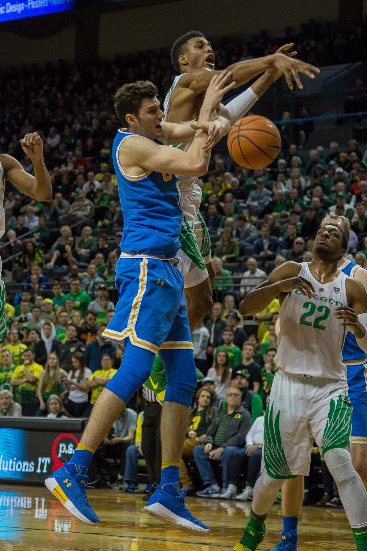 Oregon forward Kenny Wooten (#1) blocks UCLA forward Gyorgy Goloman (#14). The Oregon Ducks men's basketball team defeated the UCLA Bruins 94-91 Saturday night in front of a home crowd at Matthew Knight Arena. The win brings the Ducks 13-7 overall for the season and 3-4 in Pac-12 play. Photo by Dillon Vibes