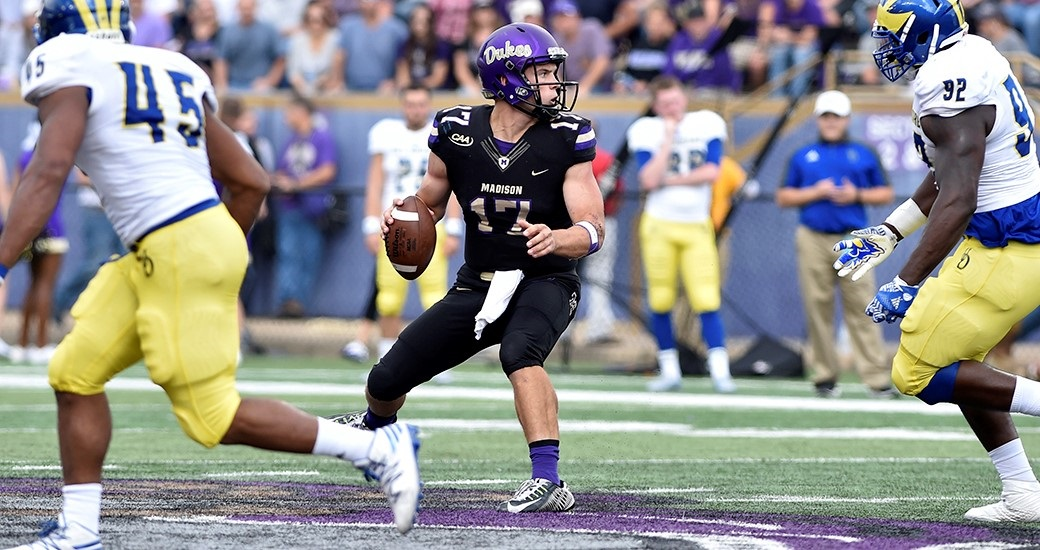 JMU 45, DELAWARE 20: QB Bryan Schor (17) scored 4 TDs to lead the seventh-ranked Dukes. He passed for 209 yards and a TD and rushed for 103 yards and 3 TDs, tying his career high. Khalid Abdullah ran for a game-high 159 yards with 2 TDs on only 10 carries. It was his fourth 100-yard game of the season. (Photo courtesy JMU Athletics)