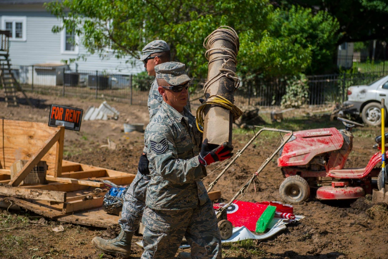 National Guard members do some heavy lifting in Clendenin. More than 500 National Guard members are deployed in West Virginia to help with flood recovery efforts. (West Virginia National Guard)