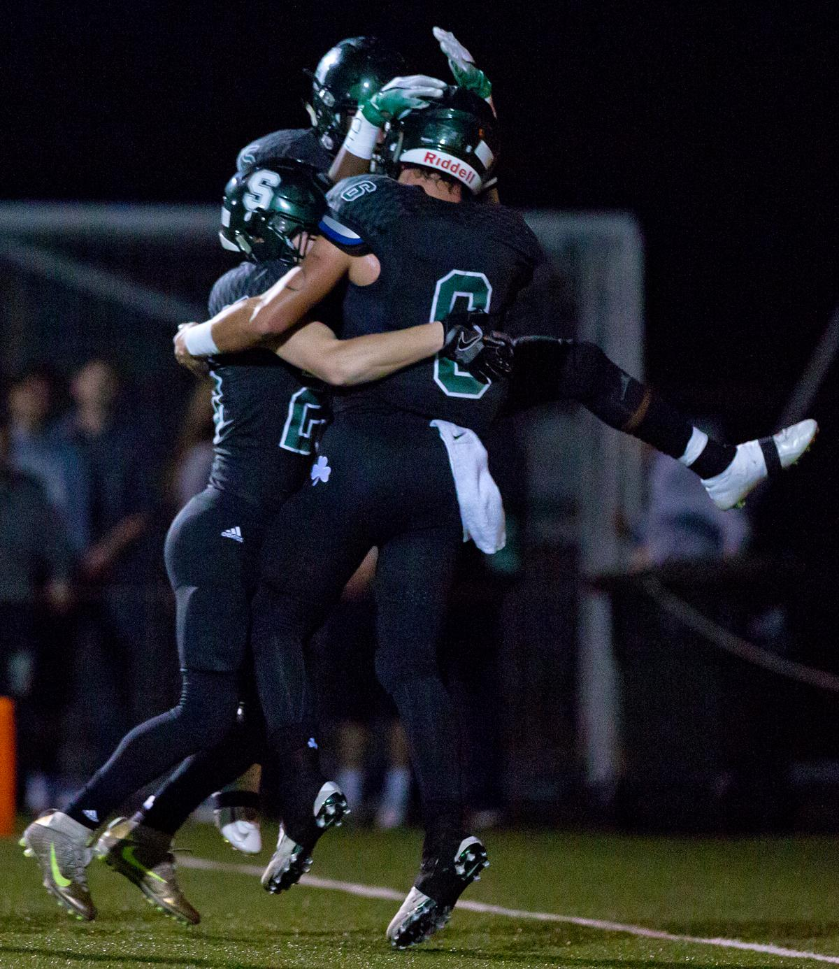 The Sheldon offense celebrates a touchdown by quarterback Zach Diehl (#6). The Sheldon Irish defeated the Lincoln Cardinals 38 to 28 to advance to the quarterfinals of the OSAA 6A playoffs. Photo by Ben Lonergan, Oregon News Lab