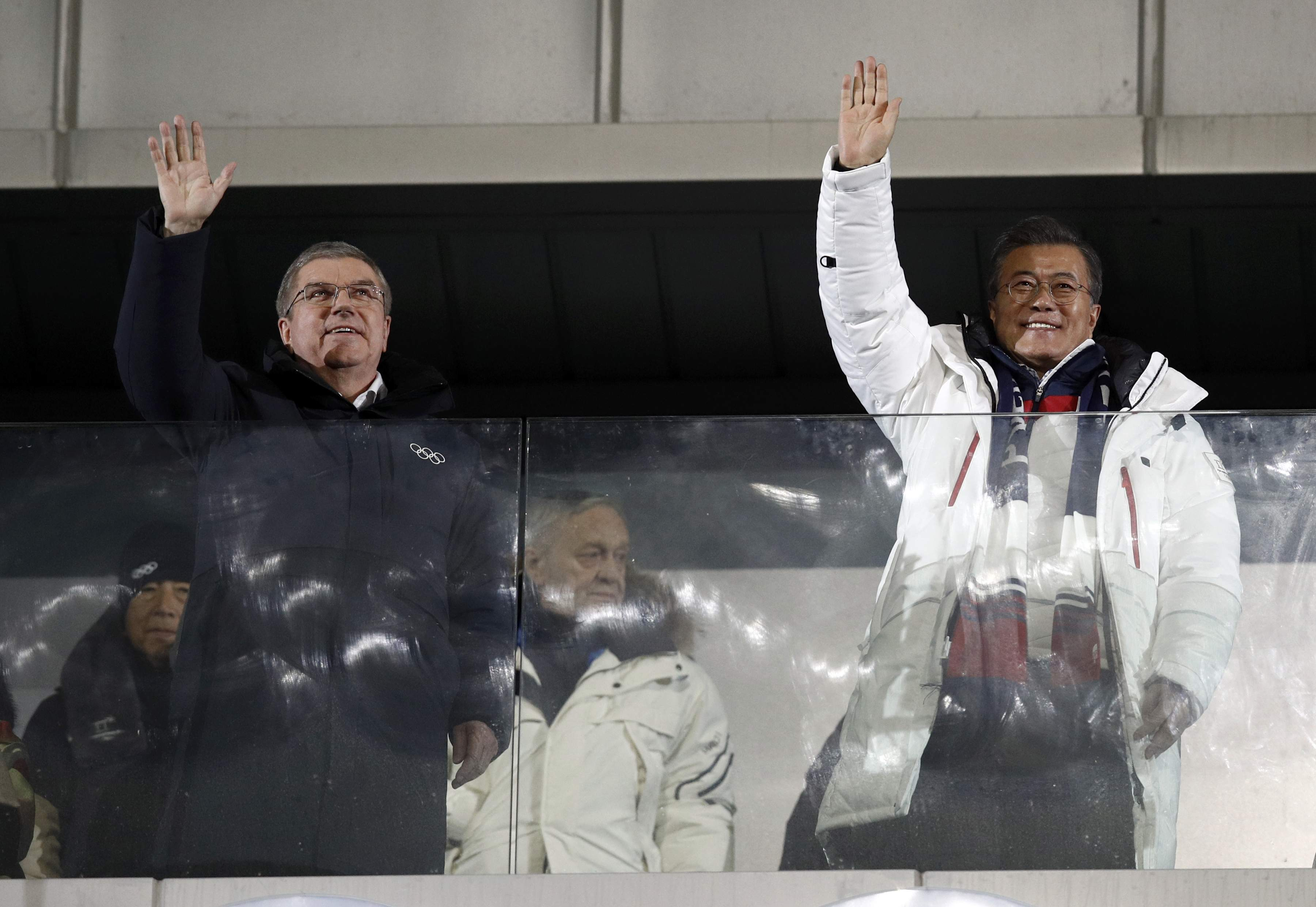 IOC president Thomas Bach and South Korean President Moon Jae-in during the opening ceremony of the 2018 Winter Olympics in Pyeongchang, South Korea, Friday, Feb. 9, 2018. (AP Photo/Jae C. Hong)