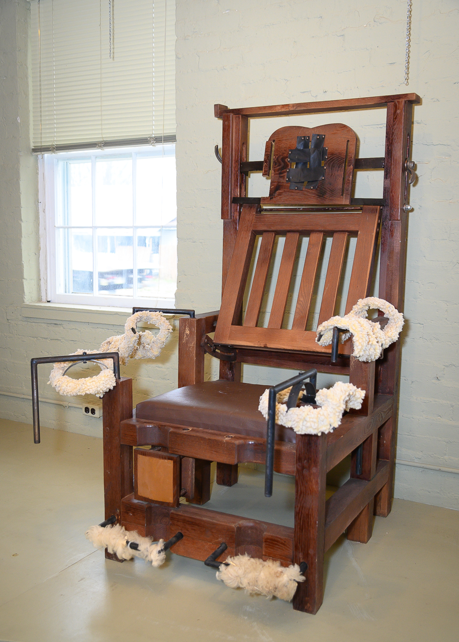 "The museum has two rather unsettling pieces exhibited. The first is a replica of an electric chair that was made in the 1920s. A local blacksmith was commissioned by the government to make a more ""humane"" electric chair for use in executions. The blacksmith, a religious conservative, initially balked at the prospect of making a device to end someone's life, but chose to make the chair in the end if it meant it would provide an easier execution for someone condemned to death. This particular chair is a replica made with the same materials and was never actually used. / Image: Phil Armstrong, Cincinnati Refined // Published: 1.7.20"