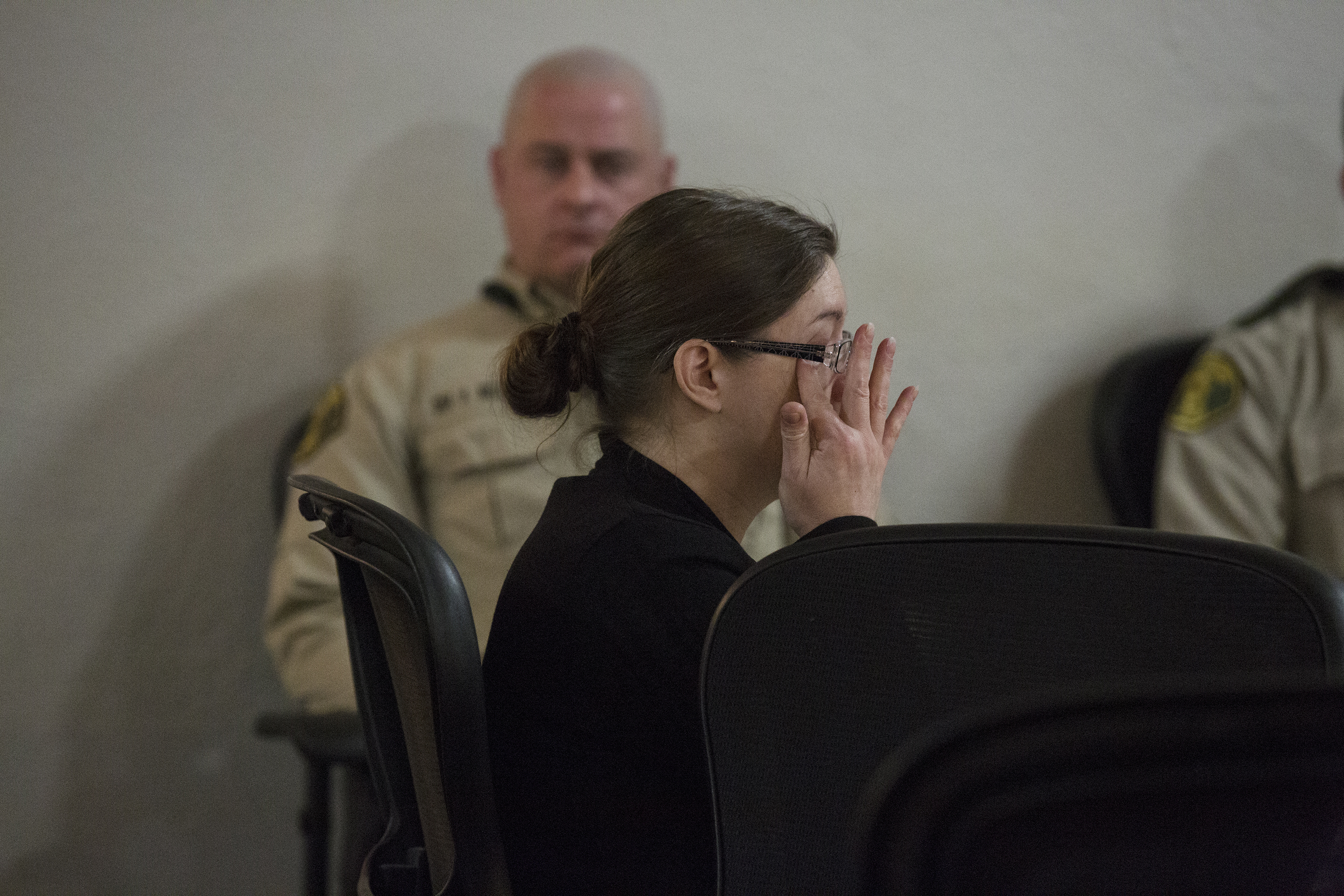 Nicole Finn, of West Des Moines, wipes the corner of her eye after the second day of testimony from Amy Sacco, a social worker for Iowa's Department of Human Services, during Finn's trial for murder, kidnapping and child endangerment on Wednesday, Dec. 6, 2017, at the Polk County Courthouse.(Kelsey Kremer /The Des Moines Register via AP, Pool)