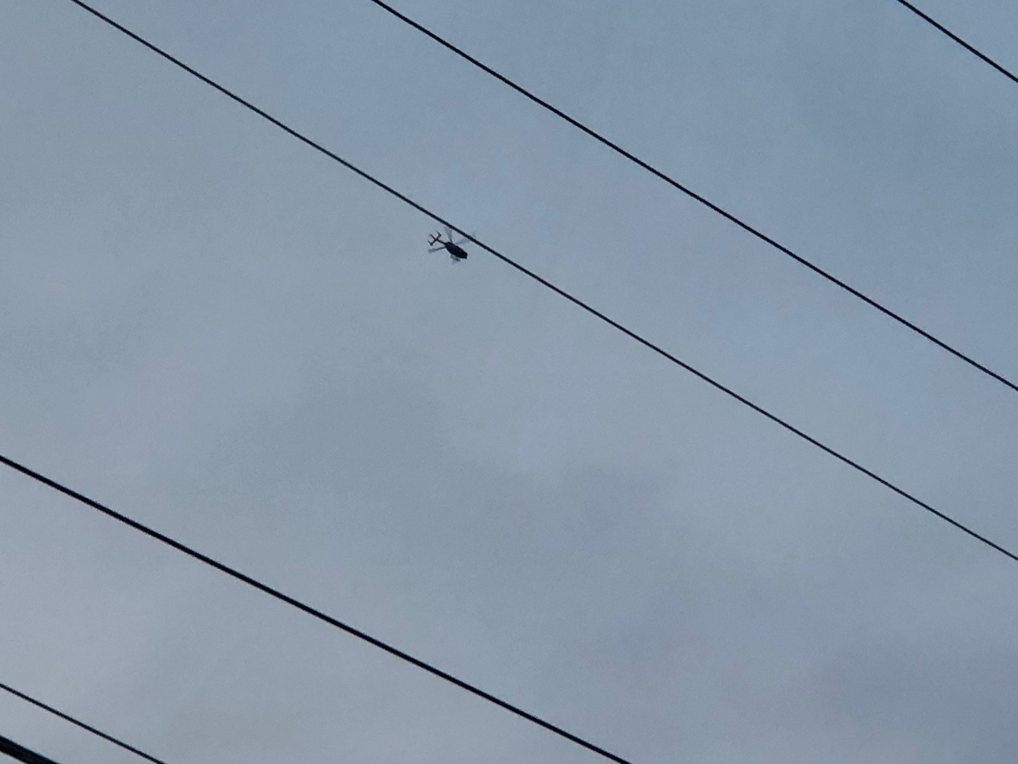 Photo shows a helicopter flying over the Huntington area. Federal authorities participated in raids on Tuesday. (WCHS/WVAH)