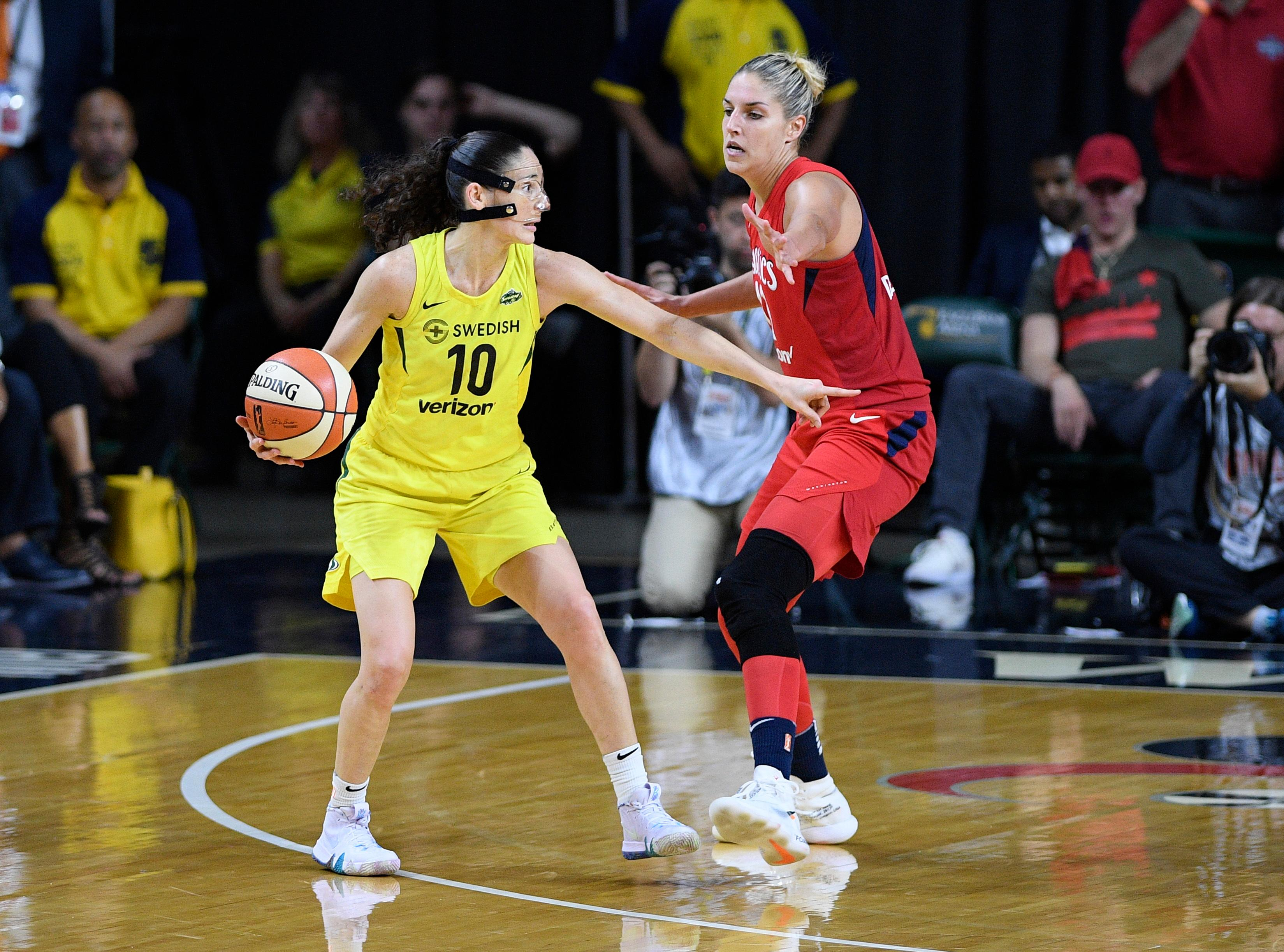 Seattle Storm guard Sue Bird (10) dribbles against Washington Mystics forward Elena Delle Donne, right, during the second half of Game 3 of the WNBA basketball finals, Wednesday, Sept. 12, 2018, in Fairfax, Va. The Storm won 98-82 and the title. (AP Photo/Nick Wass)