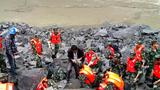 Over 120 people buried by massive southwest China landslide