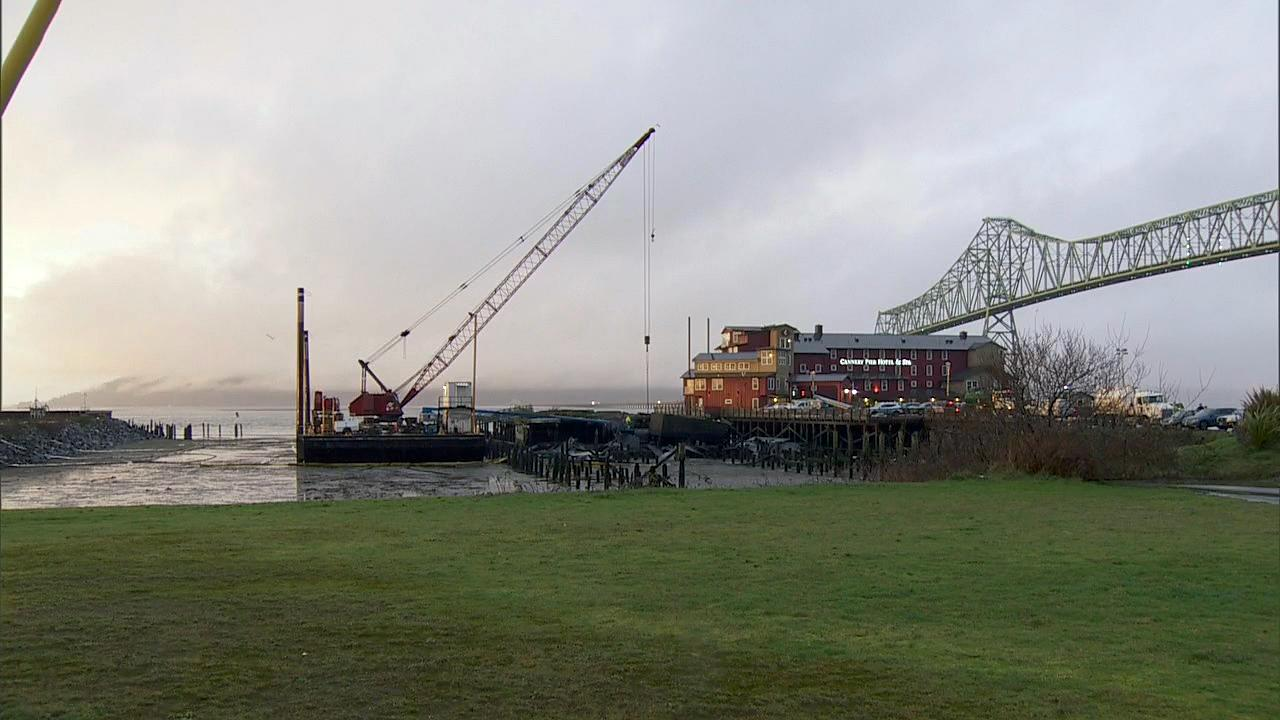 Crews began working to remove a 10,000-gallon oil tank Monday, Jan. 29, 2018 from underneath a crumbling pier in Astoria. (KATU Photo)