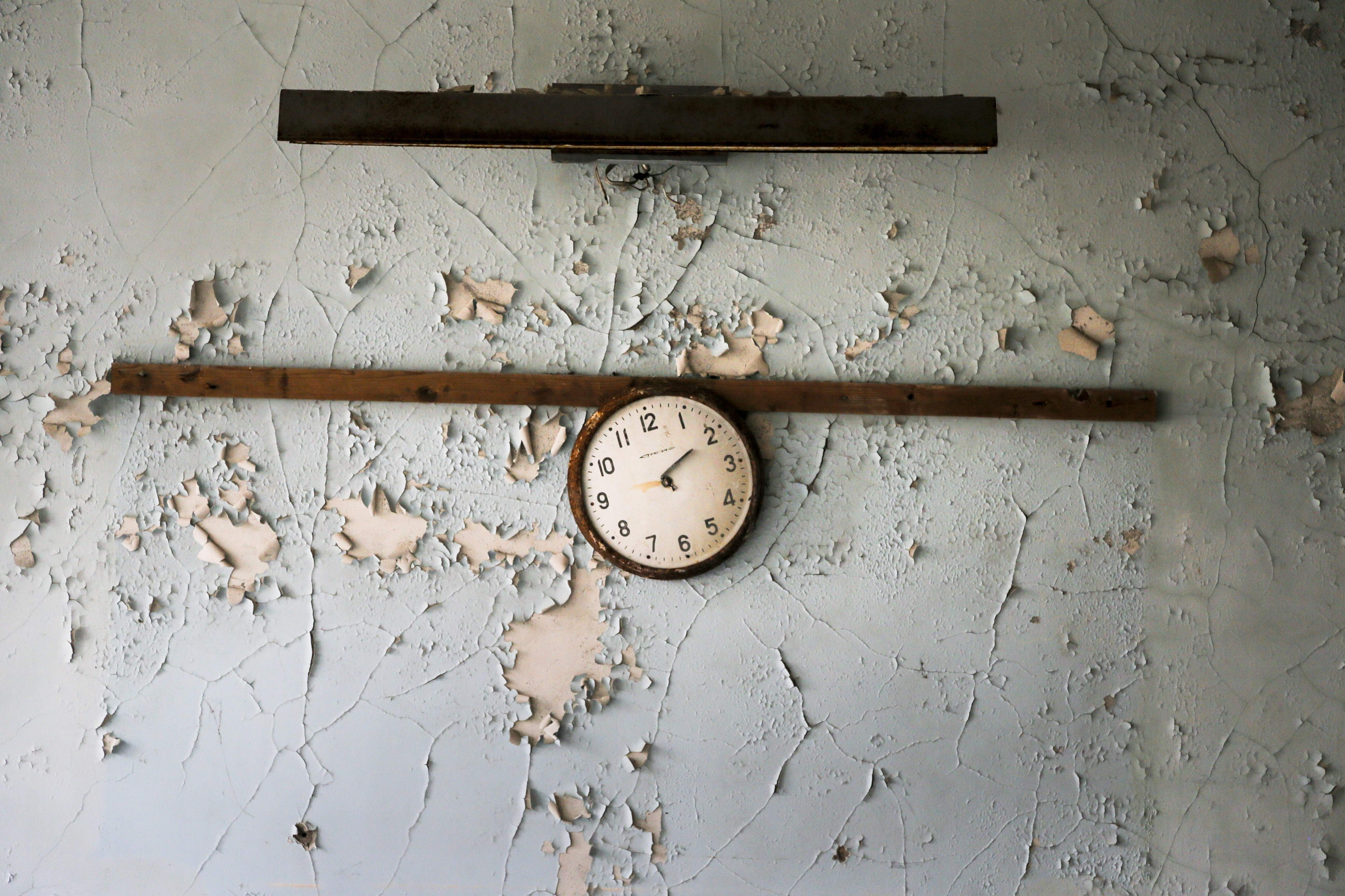 In this photo taken Wednesday, April 5, 2017, a broken clock hangs on a wall in a school in the deserted town of Pripyat, some 3 kilometers (1.86 miles) from the Chernobyl nuclear power plant Ukraine. Once home to some 50,000 people whose lives were connected to the Chernobyl nuclear power plant, Pripyat was hastily evacuated one day after a reactor at the plant 3 kilometers (2 miles away) exploded on April 26, 1986. The explosion and the subsequent fire spewed a radioactive plume over much of northern Europe. THE ASSOCIATED PRESS