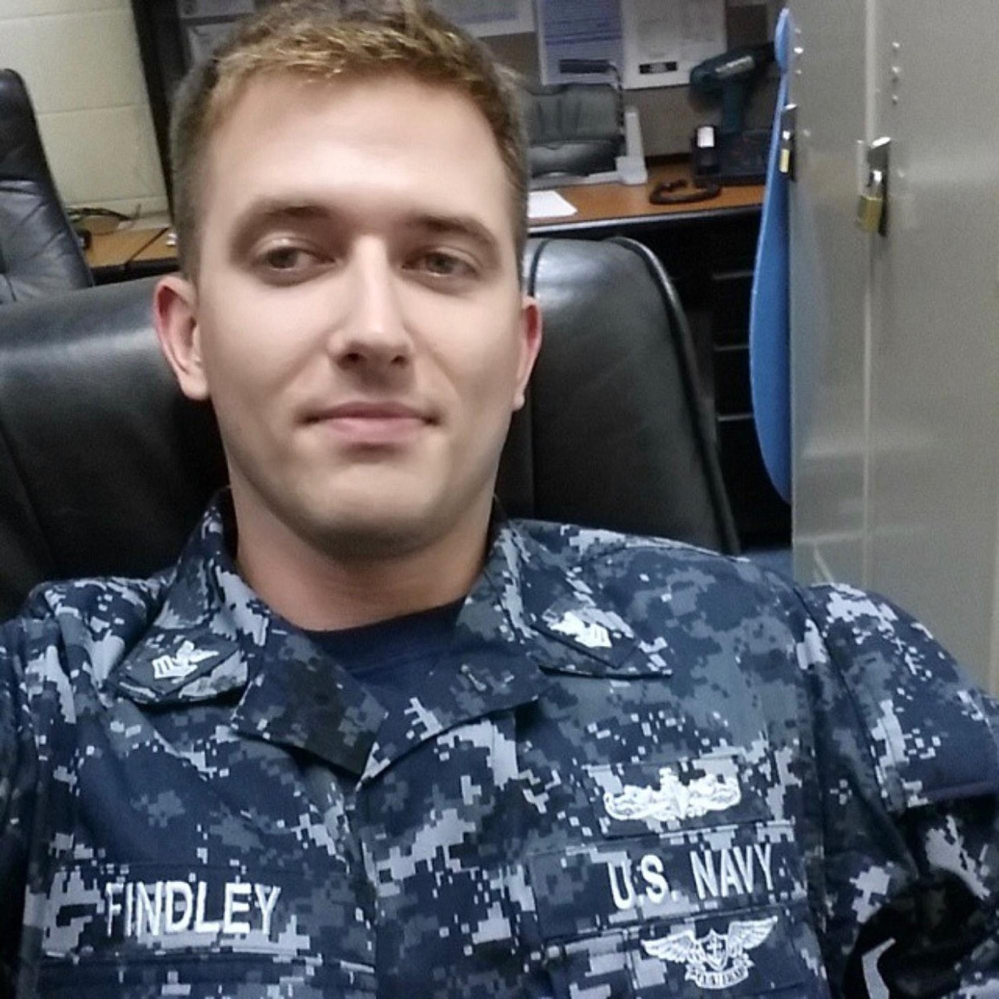 This undated photo provided by the U.S. Navy shows Electronics Technician 1st Class Charles Nathan Findley, of Missouri. Findley was stationed aboard USS John S. McCain when it collided with an oil tanker near Singapore on Monday, Aug. 21, 2017. He was identified as missing on Aug. 24. (Findley Family/U.S. Navy via AP)
