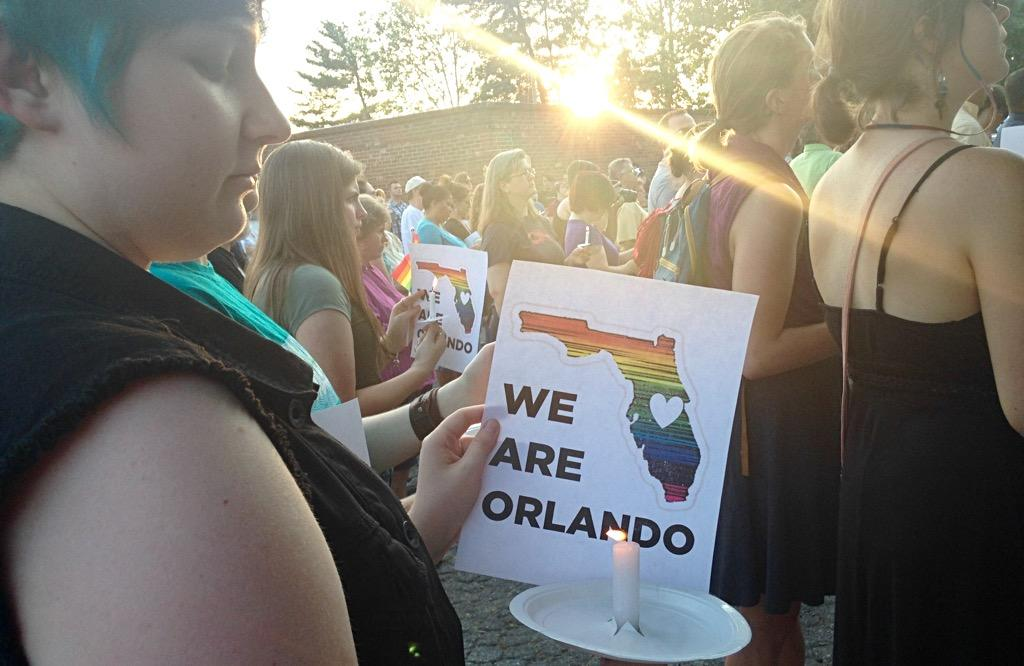 Community members gather in downtown Asheville for a vigil to remember the victims of the Orlando terrorist attack.  It was held at O'Henery's, Asheville's gay bar. (Photo credit: WLOS staff)