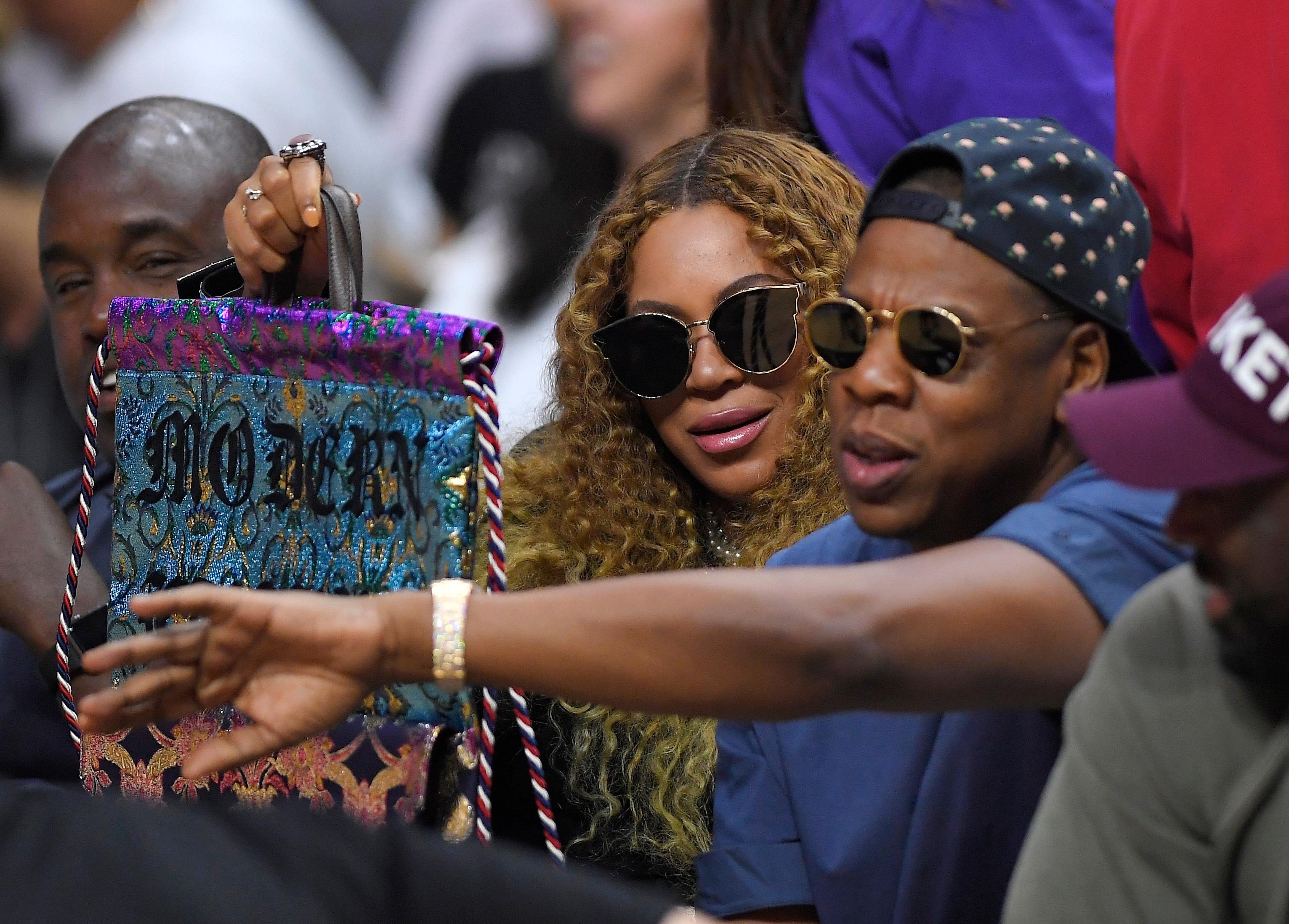 Beyonce and Jay Z watch during the first half in Game 7 of an NBA basketball first-round playoff series between the Los Angeles Clippers and the Utah Jazz, Sunday, April 30, 2017, in Los Angeles. (AP Photo/Mark J. Terrill)