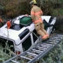 Roseburg man extricated from vehicle after crashing into creek