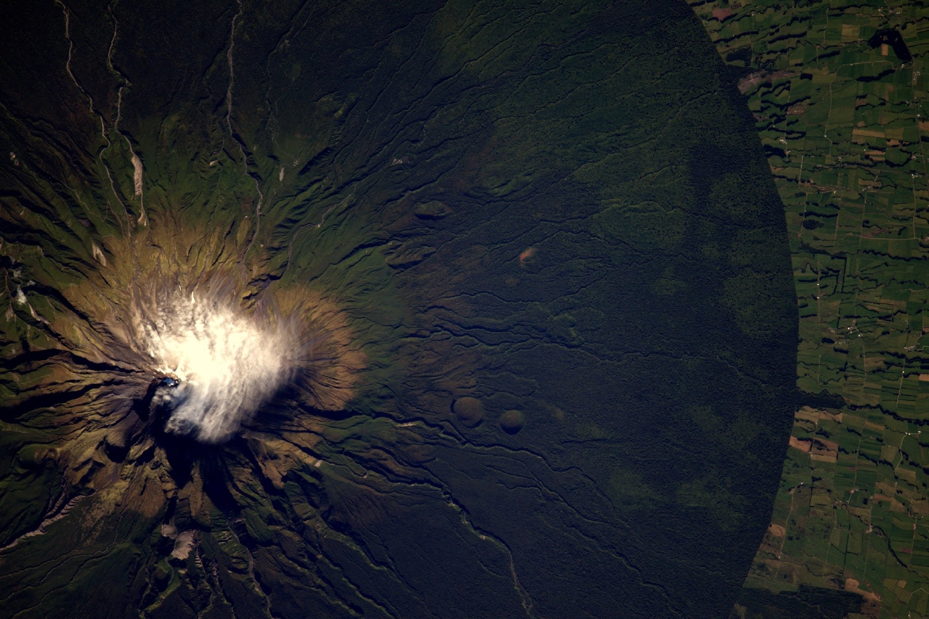 The Taranaki volcano in #NewZealand is a perfect circle emerging from the green forest (Photo & Caption: Thomas Pesquet // NASA)