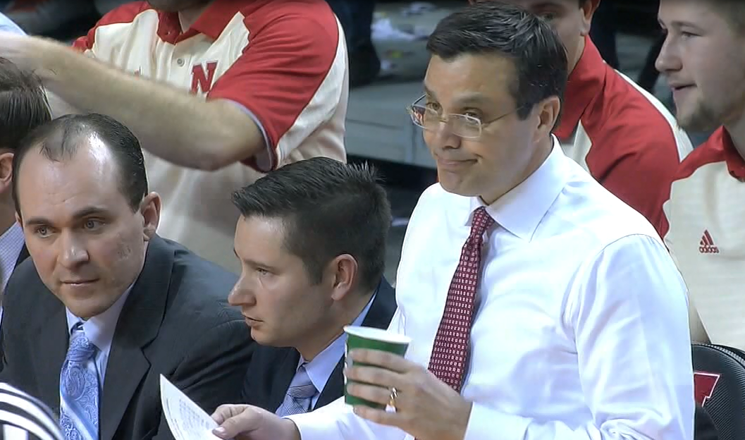 Tim Miles (right) takes a drink of water and gives a look to someone on the court (NTV News)