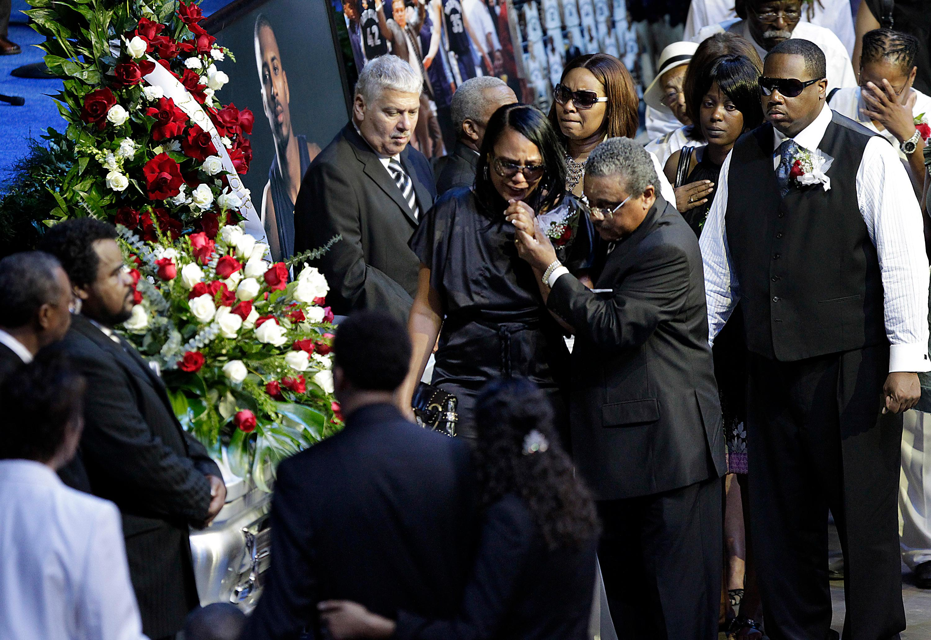 FILE - In this Aug. 4, 2010, file photo, Sherra Wright, the ex-wife of slain NBA basketball player Lorenzen Wright, grieves at the casket of Lorenzen Wright during a memorial service at the FedExForum in Memphis, Tenn. Authorities said Saturday, Dec 16, 2017, that Sherra Wright was charged with first-degree murder in the death of her ex-husband. (AP Photo/Lance Murphey, File)