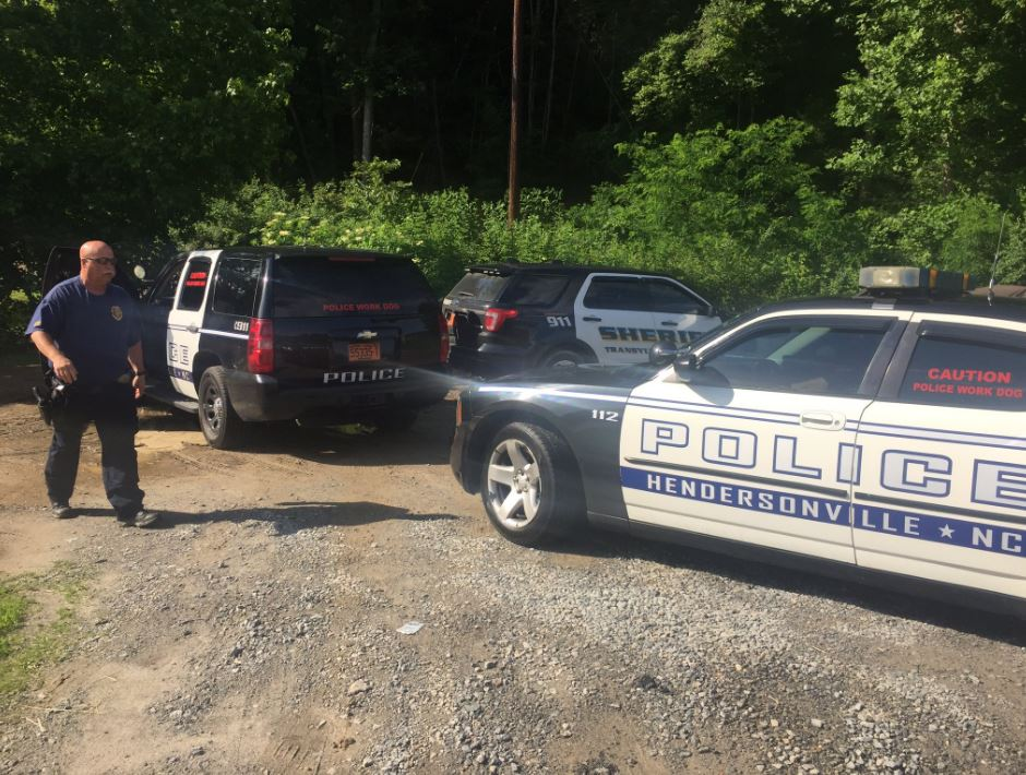 hendersonville police joined the search Thursday for a missing autistic child in Pisgah National Forest. (Photo credit: WLOS staff)