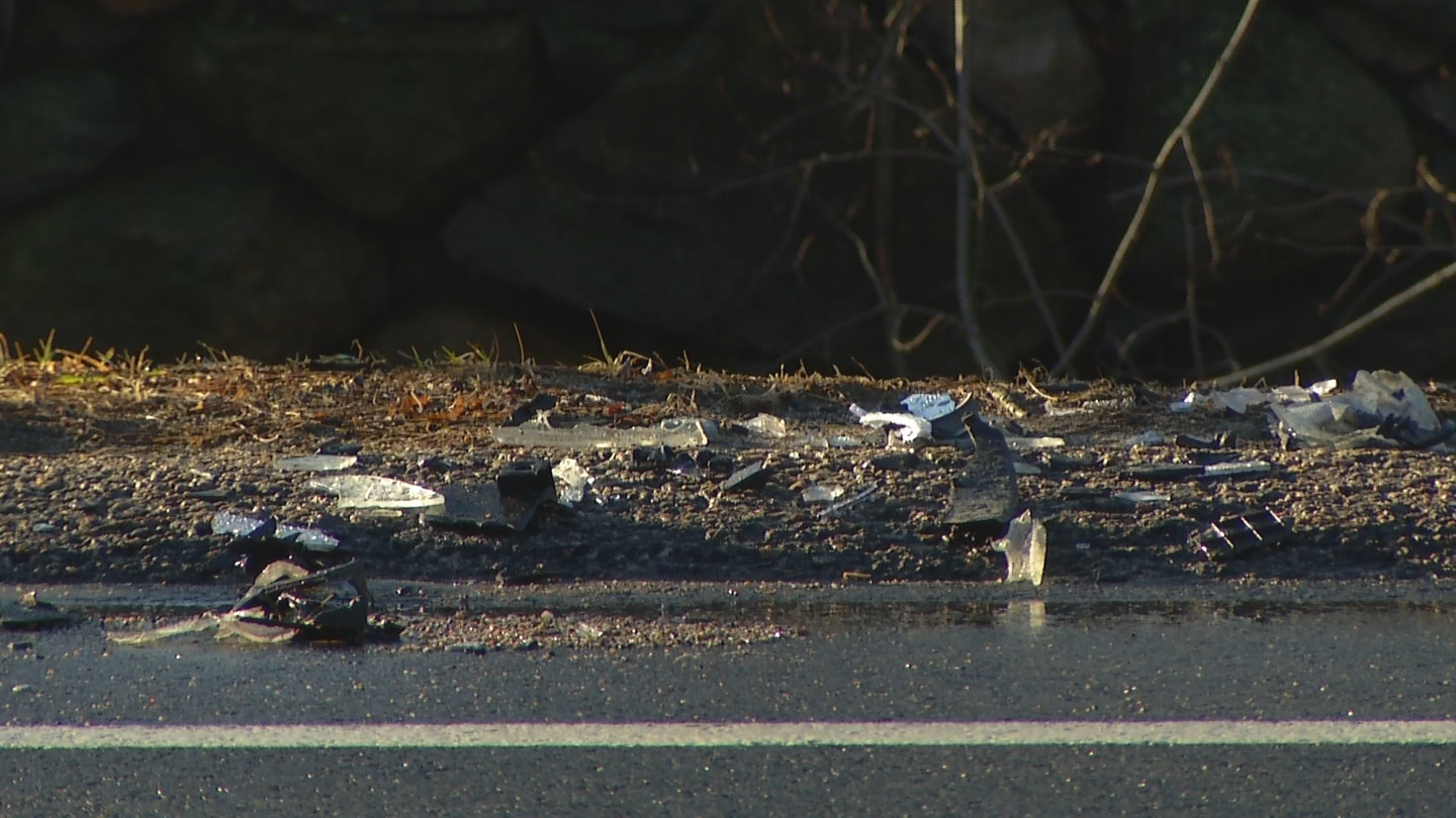 Debris litters Division Street in East Greewich where police say a woman was killed in a two-car crash. (WJAR)