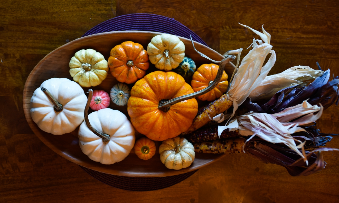 Stack pumpkins and dried corn in a wooden serving platter for an easy and festive Thanksgiving centerpiece. (Image: Rebecca Mongrain/Seattle Refined)