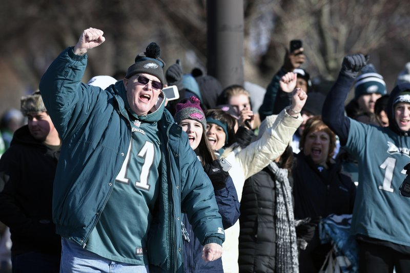 <p>Philadelphia Eagles NFL football team fans celebrate during the Super Bowl LII victory parade, Thursday, Feb 8, 2018, in Philadelphia. (AP Photo/Michael Perez)</p>