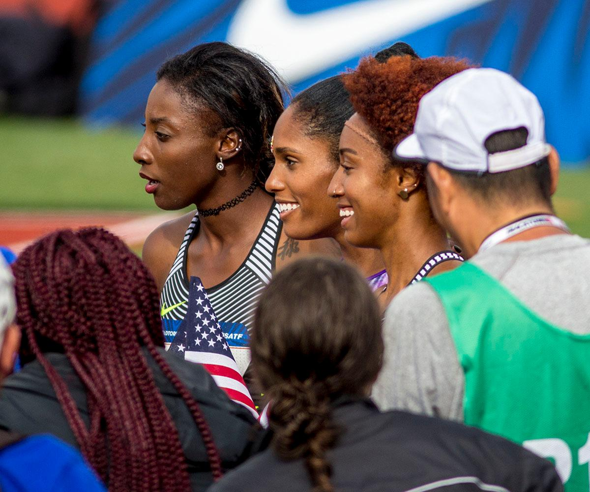 From left to right, Nia Ali, Kristi Castlin, and Brianna Rollins smile for a photo after placing in the top three in the Women�s 100m Hurdle. Ali finished third with a time of 12:55. Castlin finished second with a time of 12.50. Rollins finished first with a time of 12.34. Day eight of the U.S. Olympic Track and Field Trials took place Friday at Hayward Field in Eugene, Ore. Events continue through July 10. (Photo by Amanda Butt)
